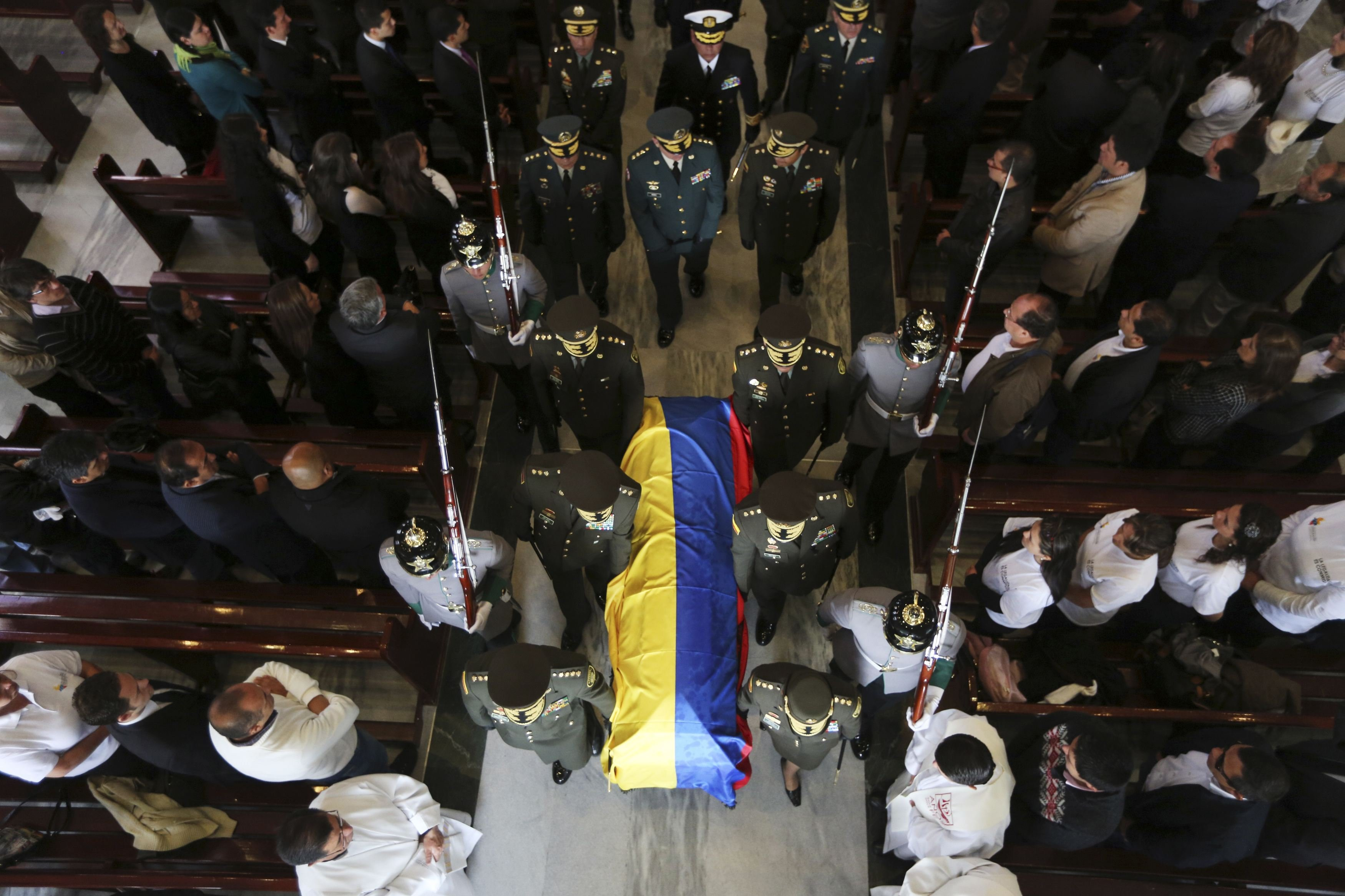 Mar. 20, 2014. Colombian police commanders carry the casket of Major German Mendez of the Colombian police force during his funeral at a religious center in Bogota, Columbia.