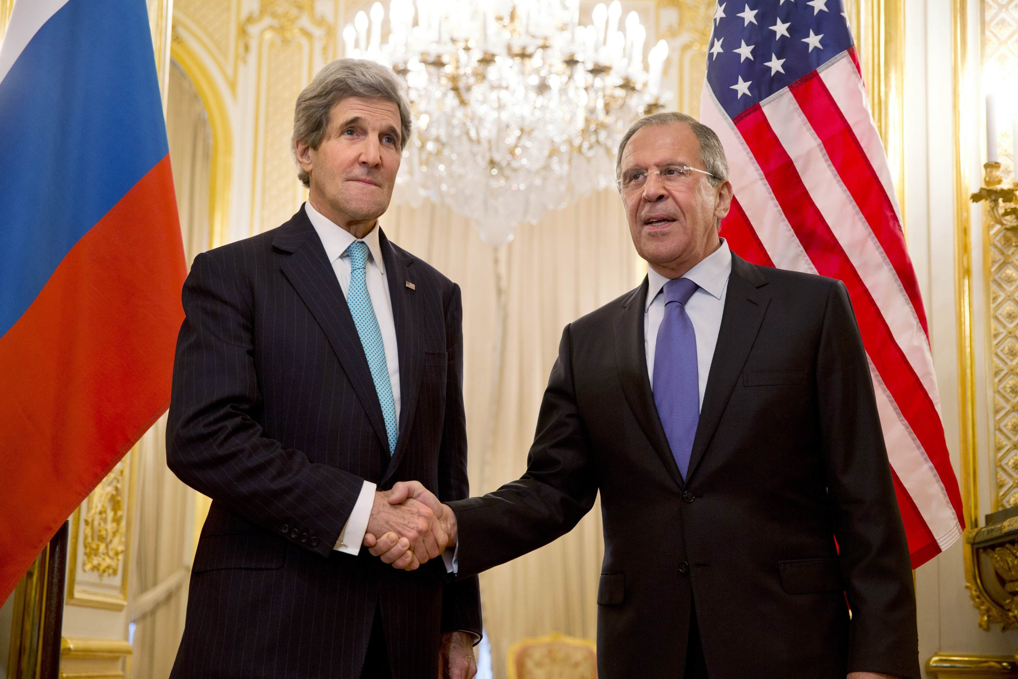 U.S. Secretary of State John Kerry, left, shakes hands with Russian Foreign Minister Sergei Lavrov before their meeting at the Russian Ambassador's residence in Paris, March 30, 2014.