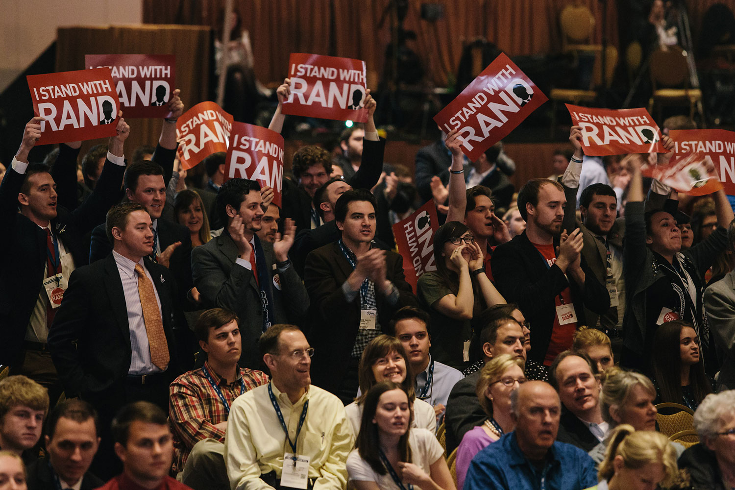 Rand Paul supporters stand and cheer when the results of a straw poll show Rand Paul winning the GOP Presidential nomination during the final day of the Conservative Political Action Conference (CPAC) at the Gaylord National Resort & Convention Center in National Harbor, Md.
