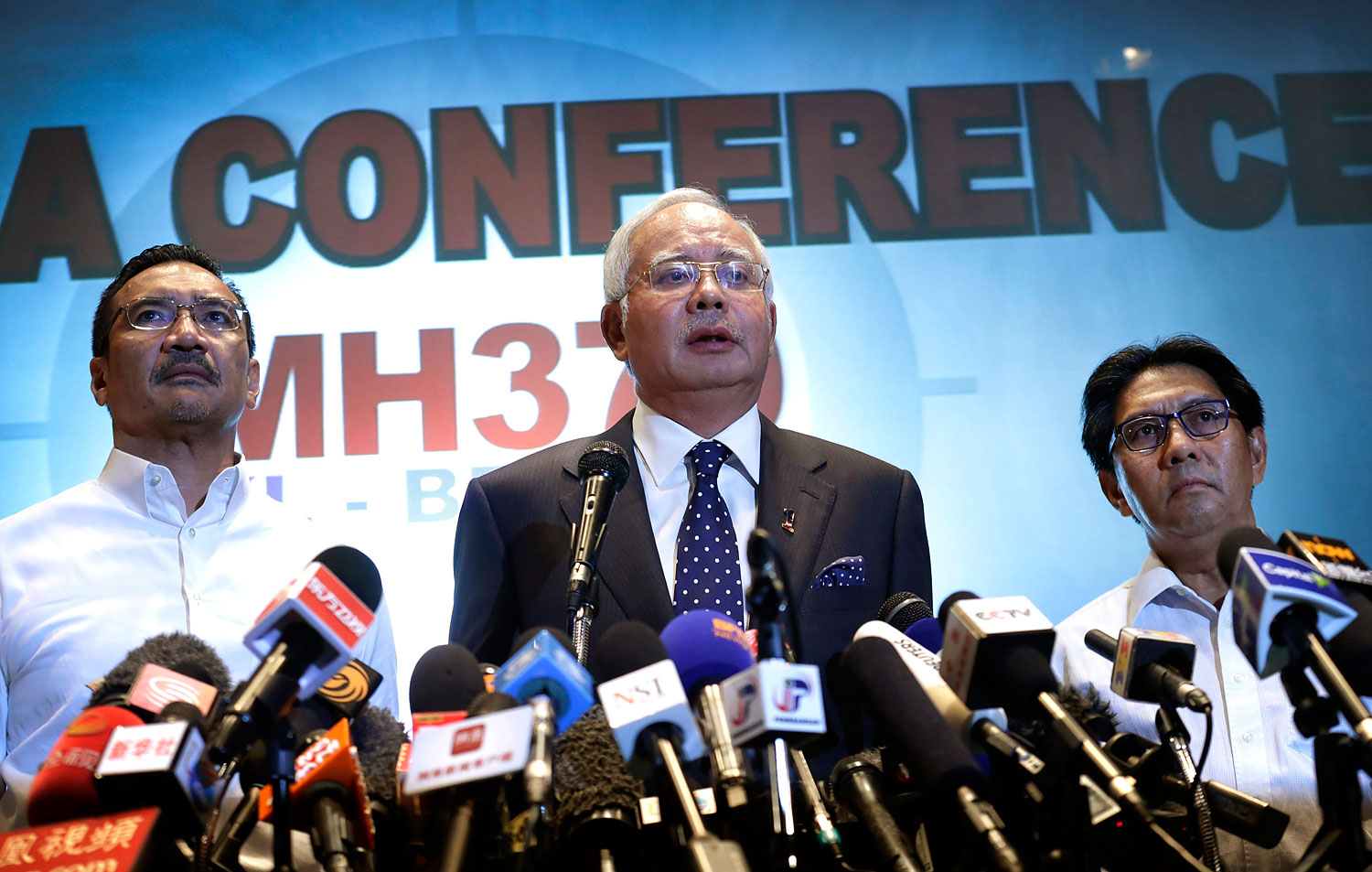 Malaysian Prime Minister Najib Razak, center; Transport Minister  Hishamuddin Hussein, left; and aviation chief Azharuddin Abdul Rahman attend a press conference on  the missing Malaysia Airlines plane on March 15, 2014, in Sepang, Malaysia