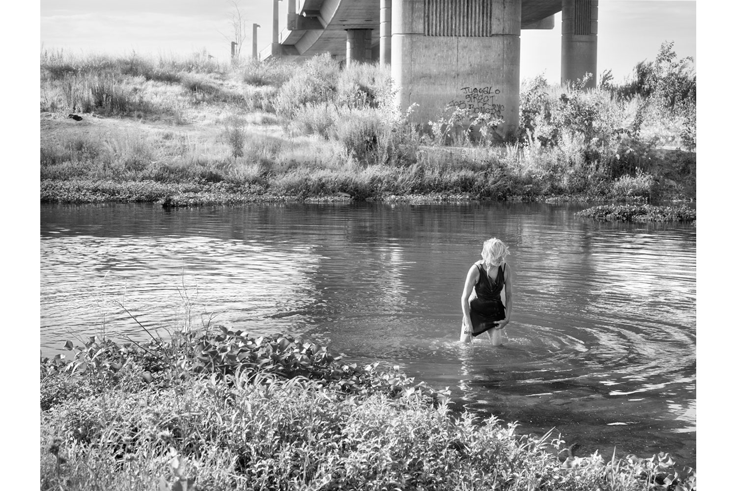 'Deb Soaking Wet, Tuolumne River, Modesto, CA, 2013,' from Kathy Grannan's The 99, published by The Fraenkel Gallery and Salon 94