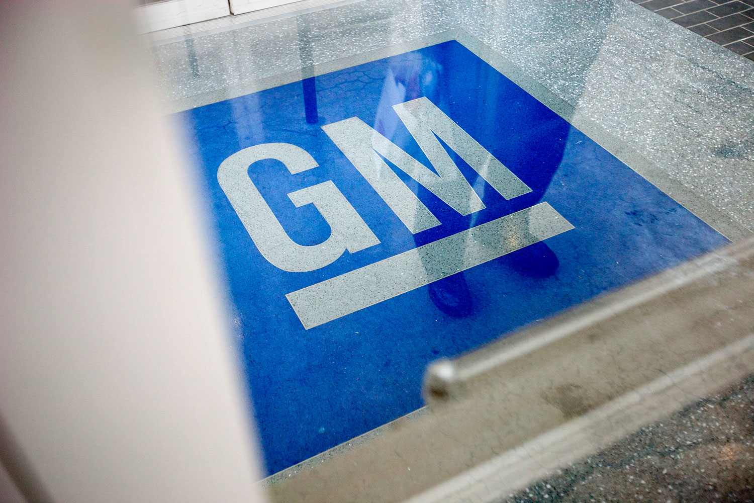 The logo for General Motors at the entrance at the site of a GM information technology center in Roswell, Ga., on Jan. 10, 2013.