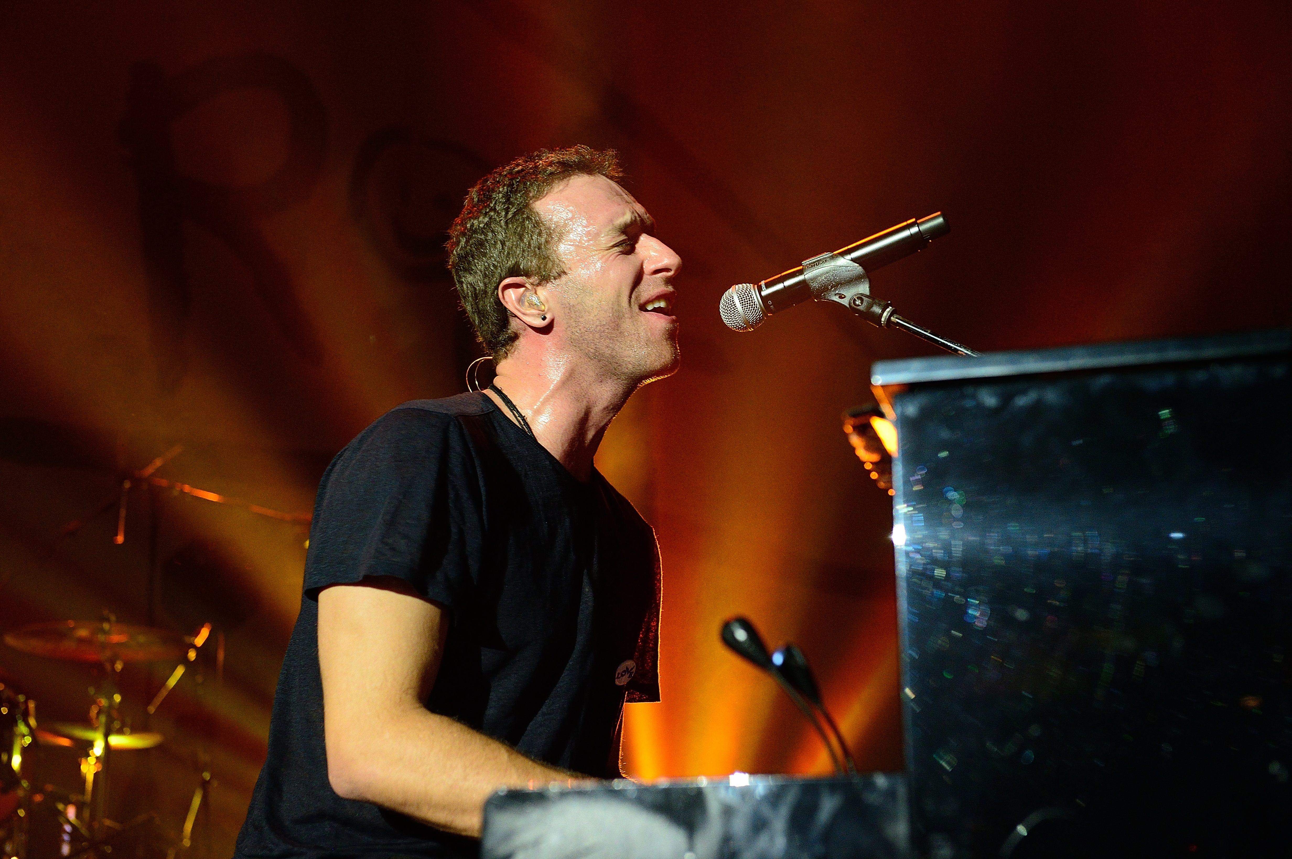 Chris Martin of Coldplay performs on stage at the 'Under 1 Roof' concert in aid of Kids Company at Hammersmith Apollo on December 19, 2013 in London, England.