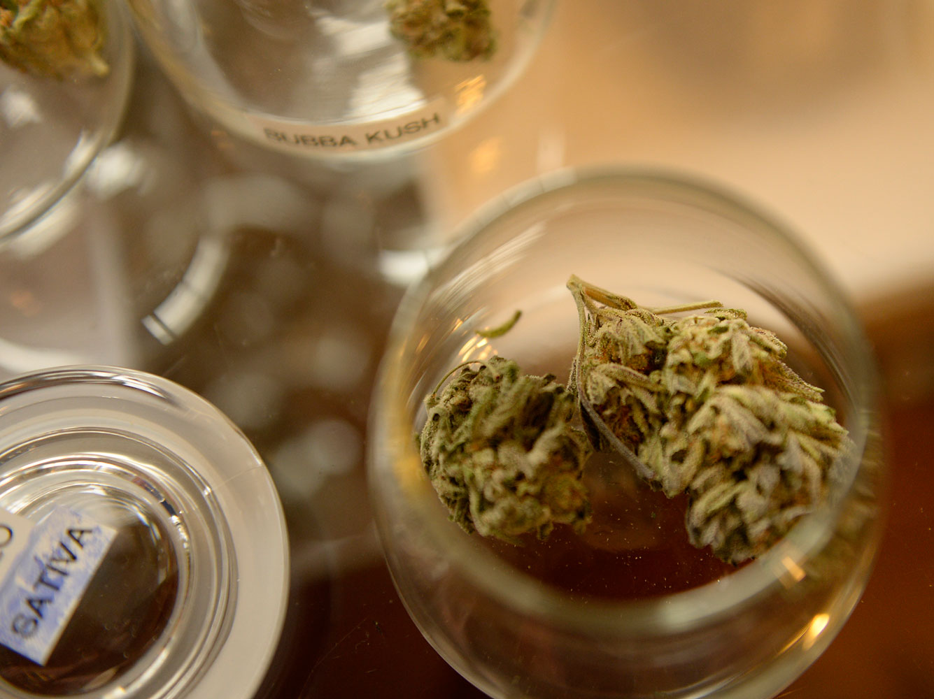 Marijuana in jars for customers to view at 3D Cannabis Center in Denver, Jan. 01 2014.