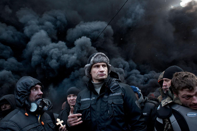 Vitali Klitschko , an opposition leader, visits the barricade on Hrushevskoho street in the morning to adress protesters on January 23, 2014 in Kiev, Ukraine.