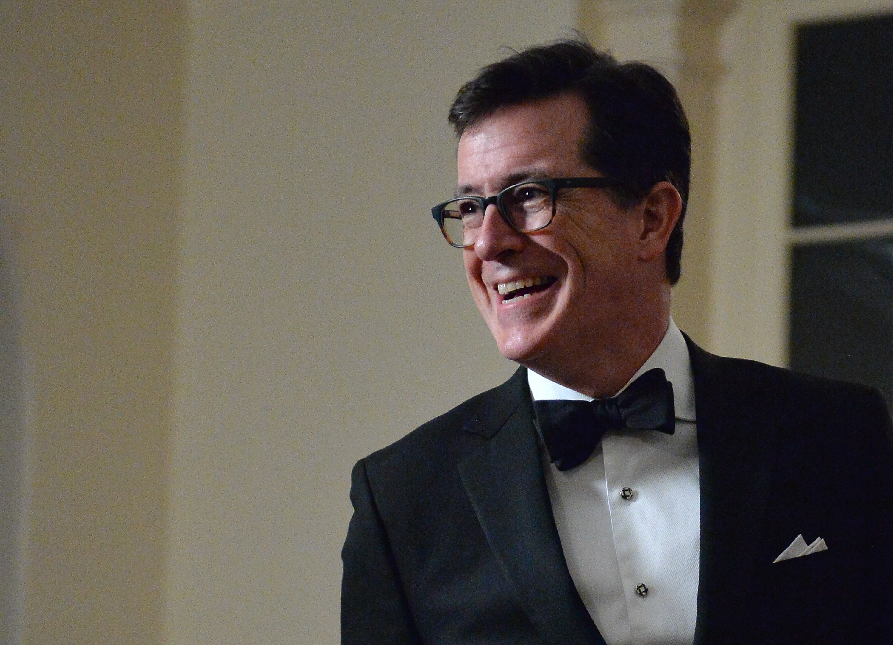 Stephen Colbert arrives at the White House in Washington on Feb. 11, 2014 for the state dinner in honor of French President Francois Hollande.