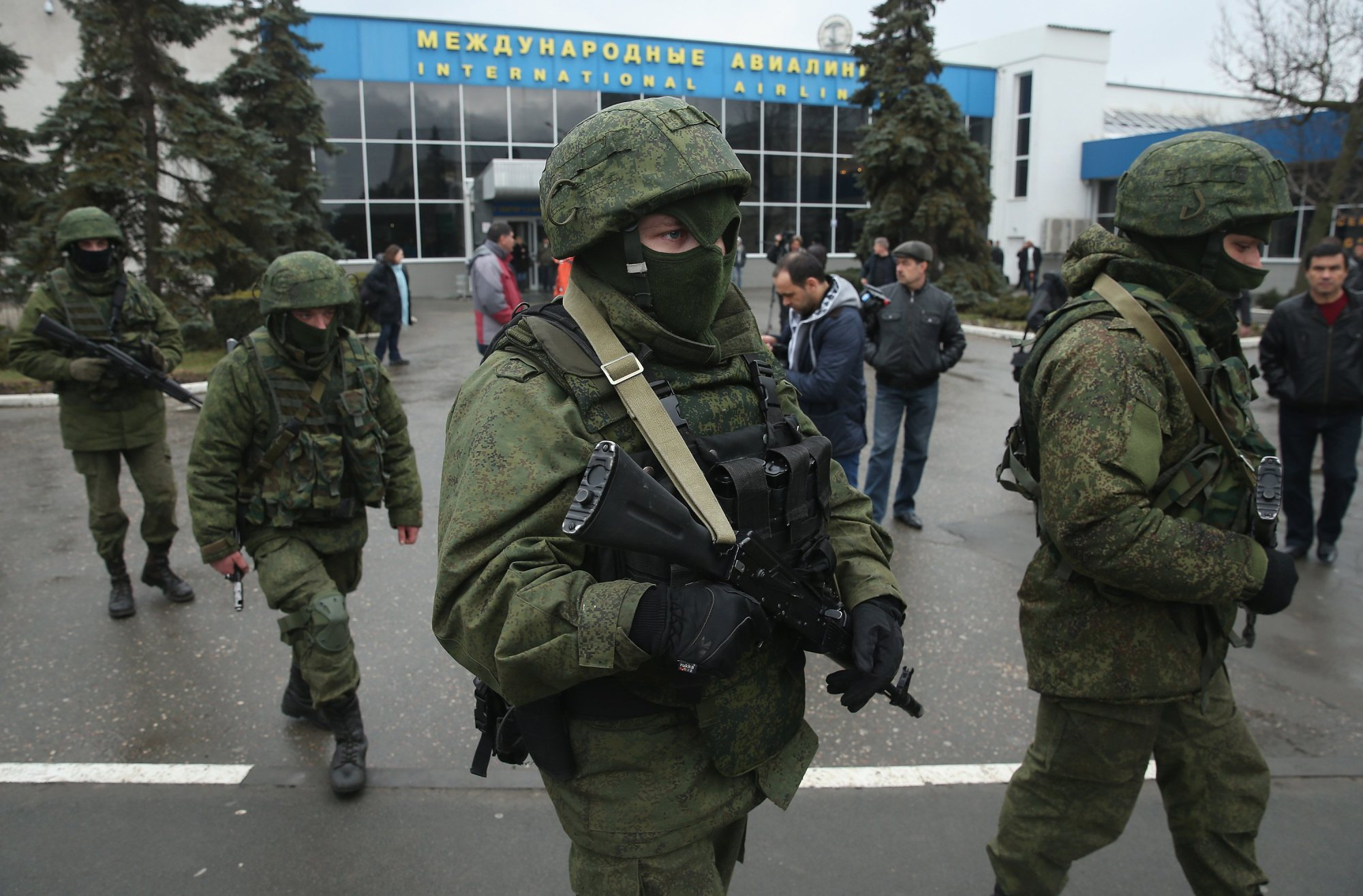 Soldiers, who were wearing no identifying insignia and declined to say whether they were Russian or Ukrainian, patrol outside the Simferopol International Airport after a pro-Russian crowd had gathered on Feb. 28, 2014.