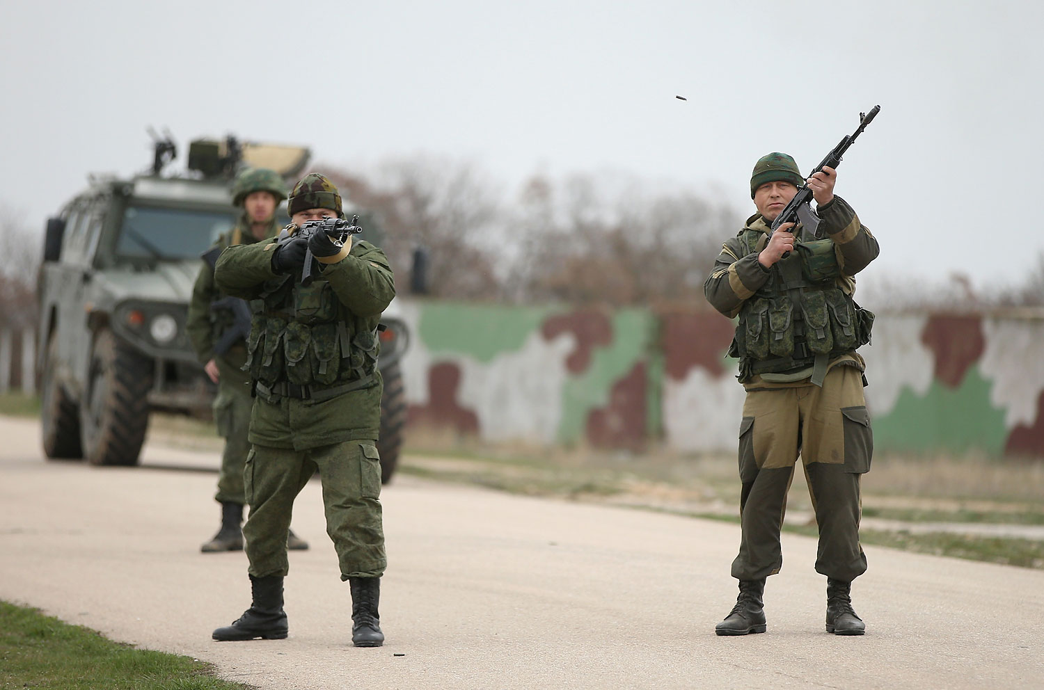 Troops under Russian command fire weapons into the air and scream orders to turn back at an approaching group of over 100 hundred unarmed Ukrainian troops at the Belbek airbase, which the Russian troops are occcupying, in Lubimovka, Crimea on March 4, 2014.