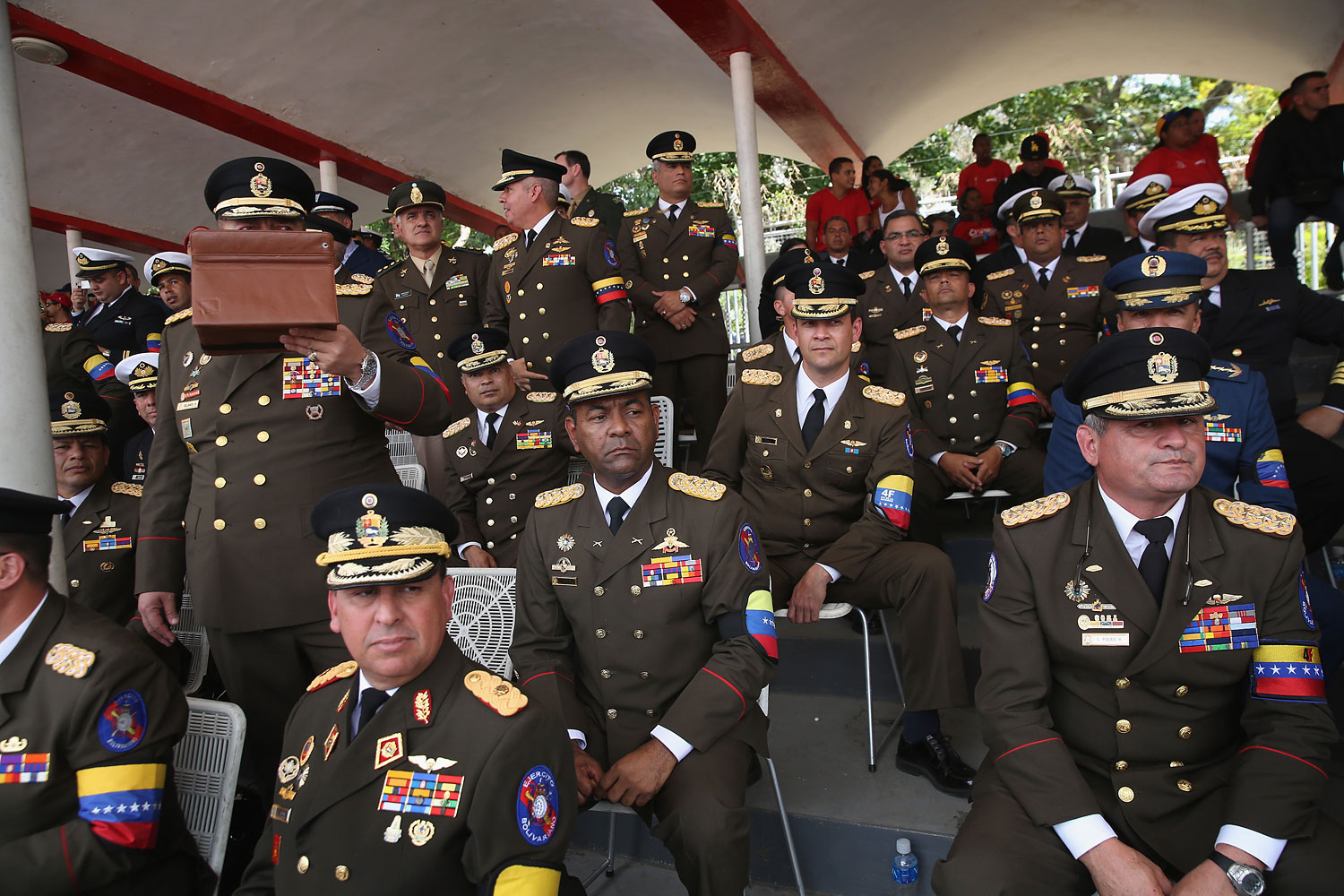 Venezuelan military officers watch an official parade marking the first anniversary of Hugo Chavez death on March 5, 2014 in Caracas.
