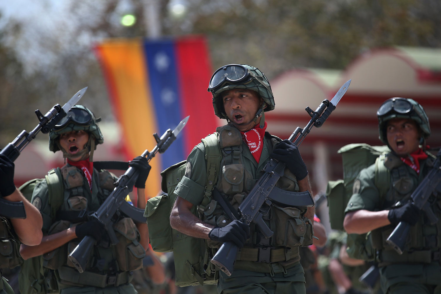 Venezuelan soldiers pass by dignitaries while marking the first anniversary of the death of Hugo Chavez on March 5, 2014 in Caracas.