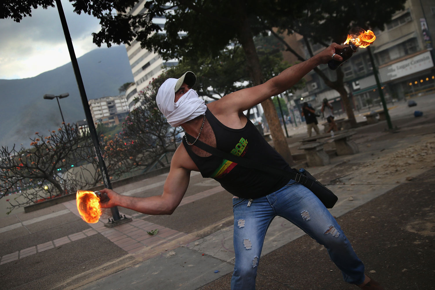 A protester throws a molotov cocktail at Venezuelan security forces during an anti-government demonstration on March 6, 2014 in Caracas.