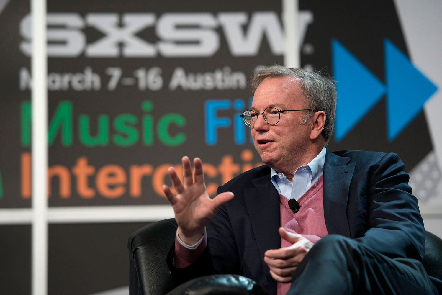 Eric Schmidt, executive chairman of Google Inc., speaks during a featured session called The New Digital Age, at the South By Southwest Interactive Festival in Austin, Texas, March 7, 2014.