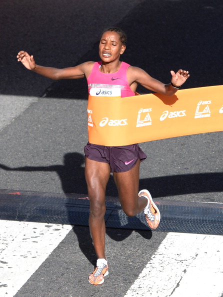 Amane Gobena of Ethiopia reacts as she crosses the finish line to win  the women's elite class of the Los Angeles Marathon on March 9, 2014 in Santa Monica, California.