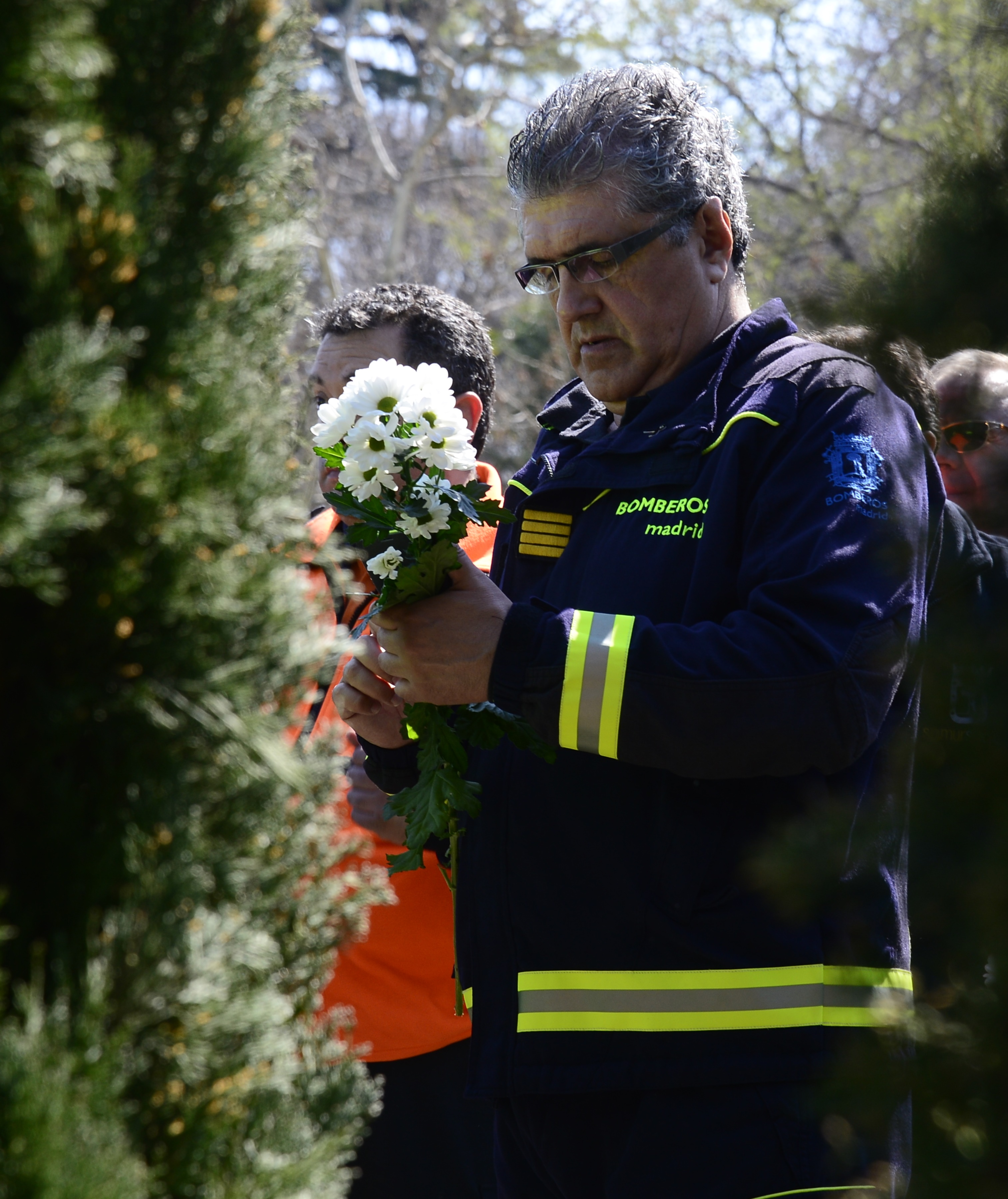Local Police wait to lays flowers during a commemoration ceremony in held in the Rememberance Garden of Madrid's Retiro Park on March 11, 2014