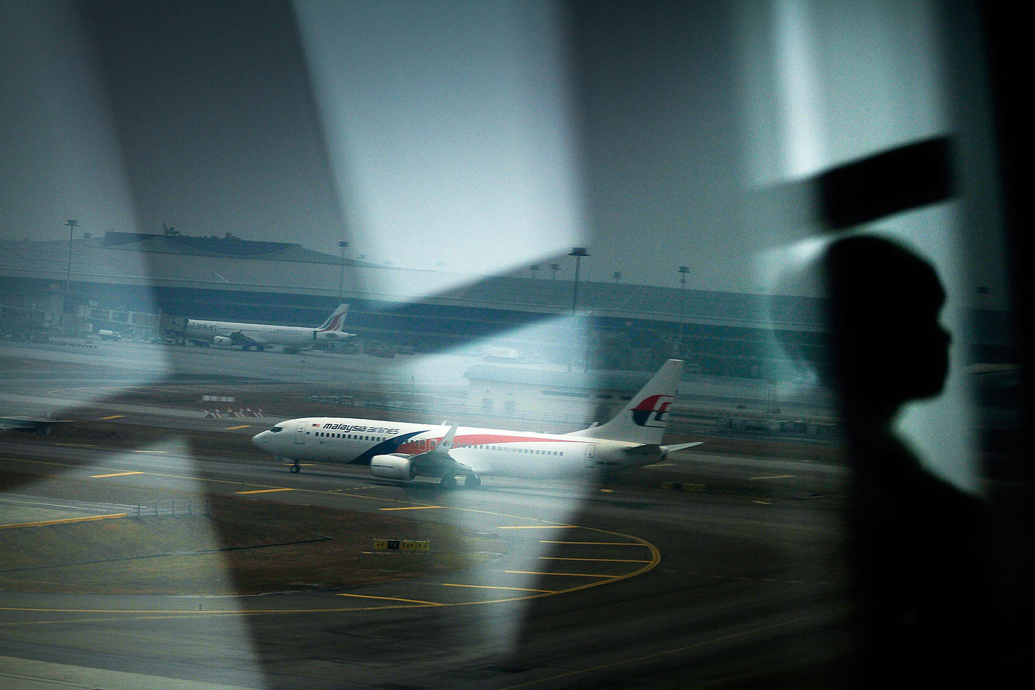 A Malaysian Airlines plane is seen on the tarmac at Kuala Lumpur International Airport on March 12, 2014 in Kuala Lumpur.