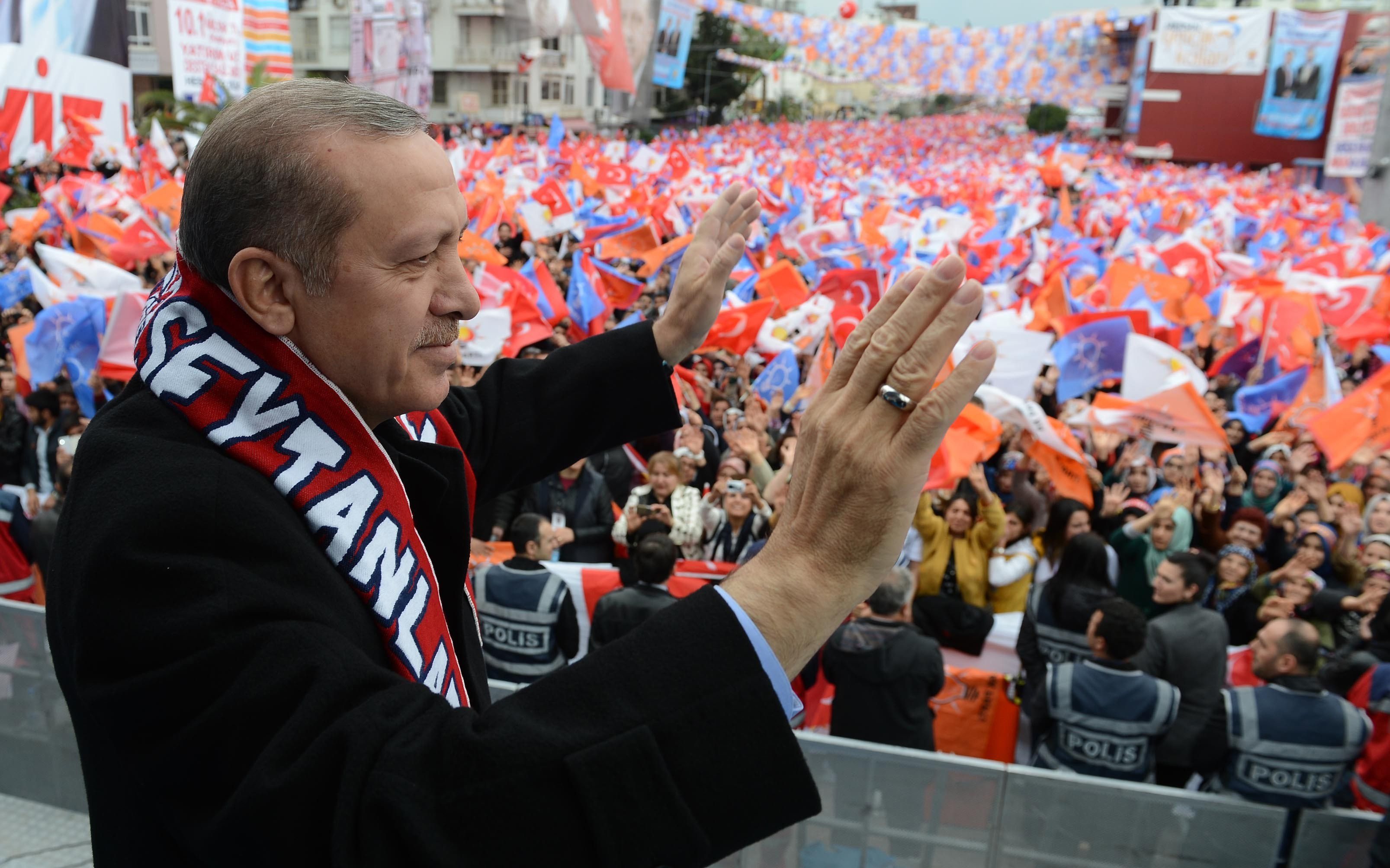 Turkish Prime Minister Recep Tayyip Erdogan greets the crowd during a local election rally organized by the ruling Justice and Development Party (AKP) in Mersin, Turkey on March 13, 2014