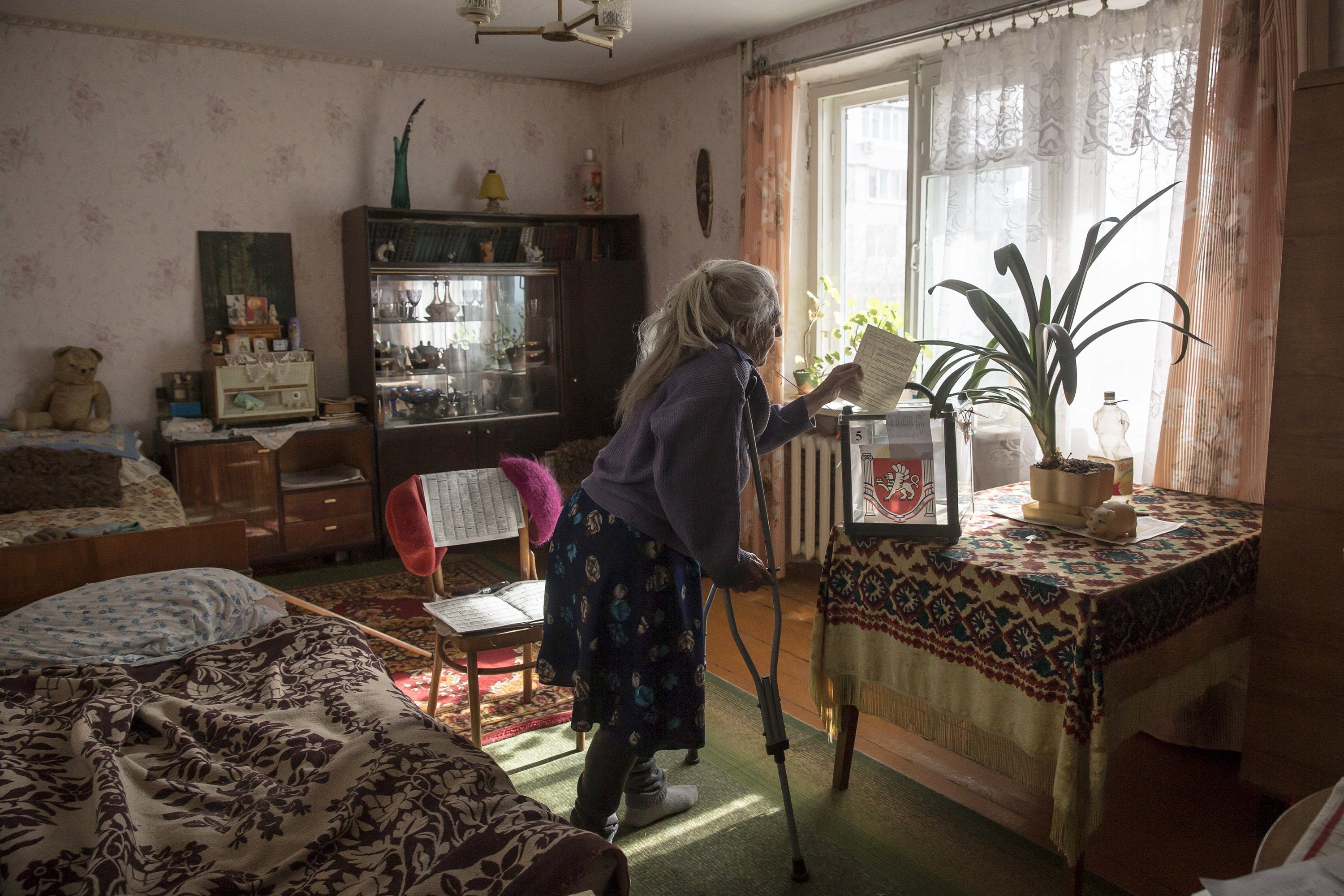 Mar. 16, 2014. Crimean, Solodkova Natalia who was too infirm to visit a polling station casts her vote at her home in a prodominantly Russian area of Bachchisaray, Ukraine.