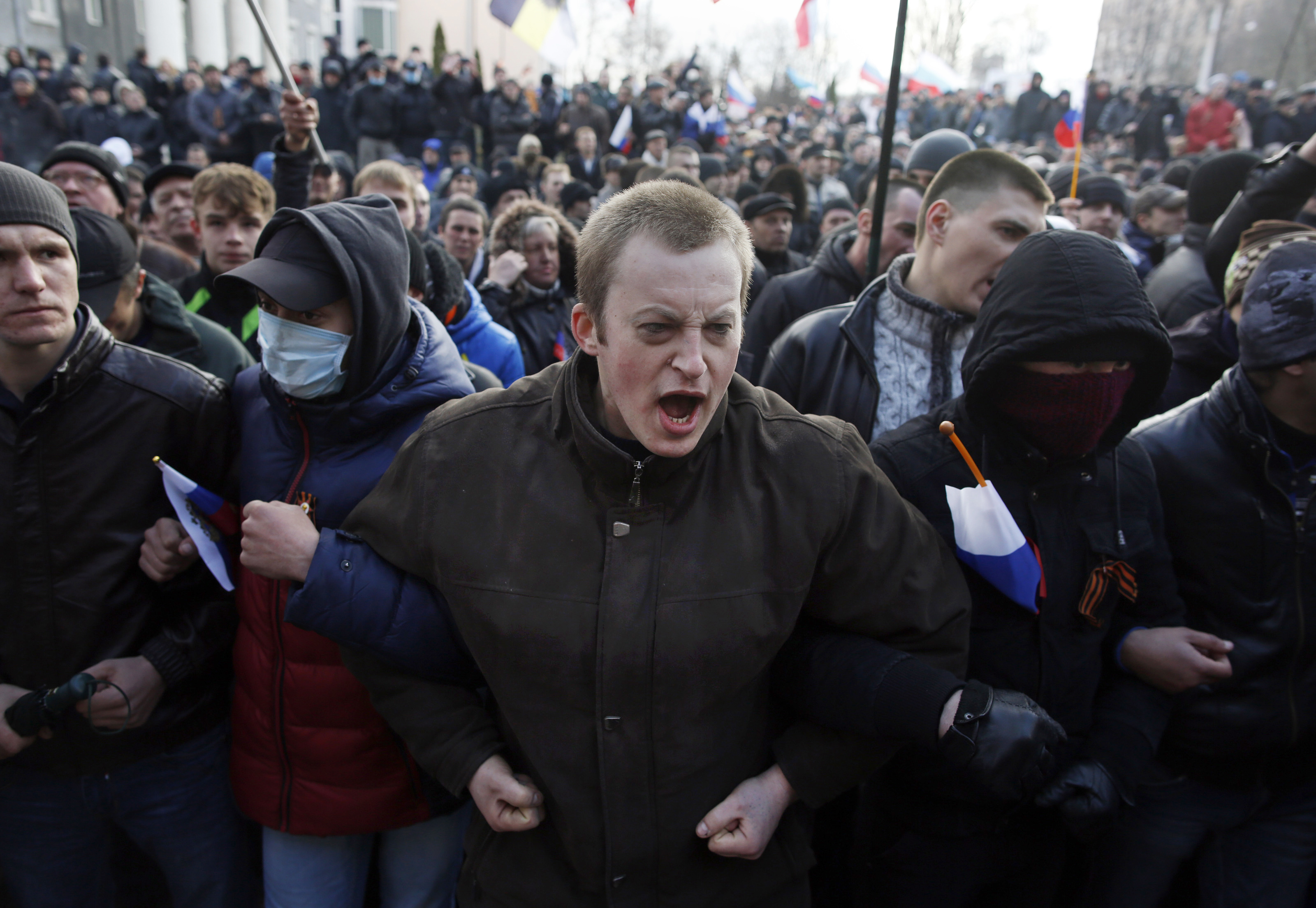 DONETSK, UKRAINE - MARCH 16: Pro-Russian protesters chant outside of the Donetsk Prosecutors Building before storming into the building during a protest in Donetsk, Ukraine on March 15, 2014.