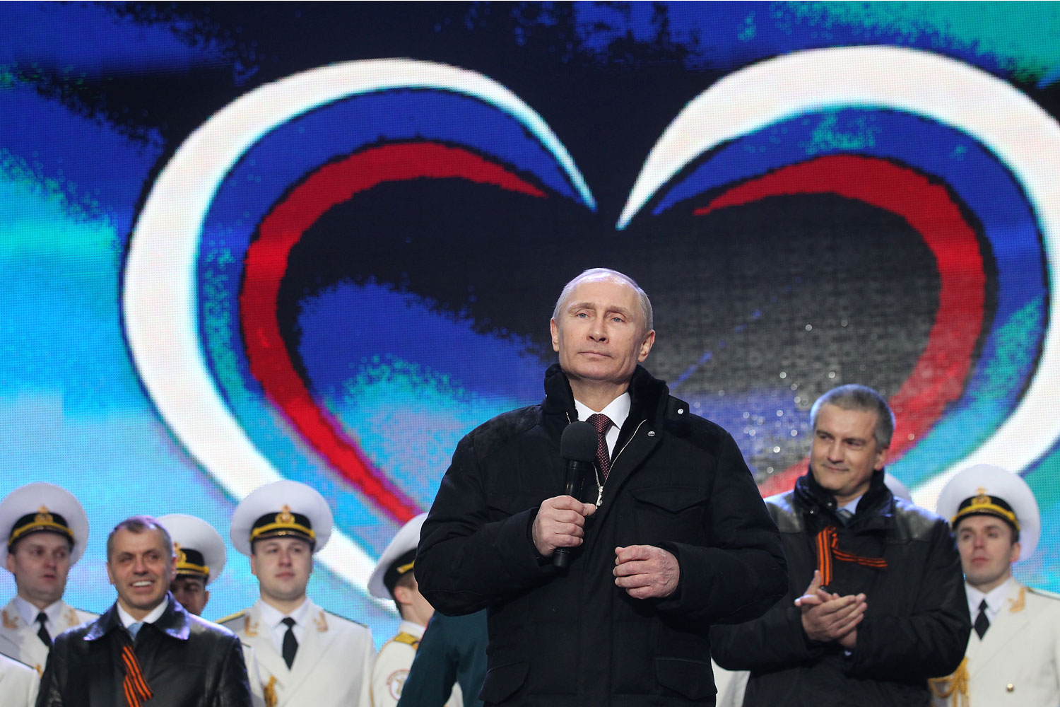 Russian President Vladimir Putin and Crimean Prime Minister Sergei Aksyonov attend a rally at Red Square on March 18, 2014 in Moscow.