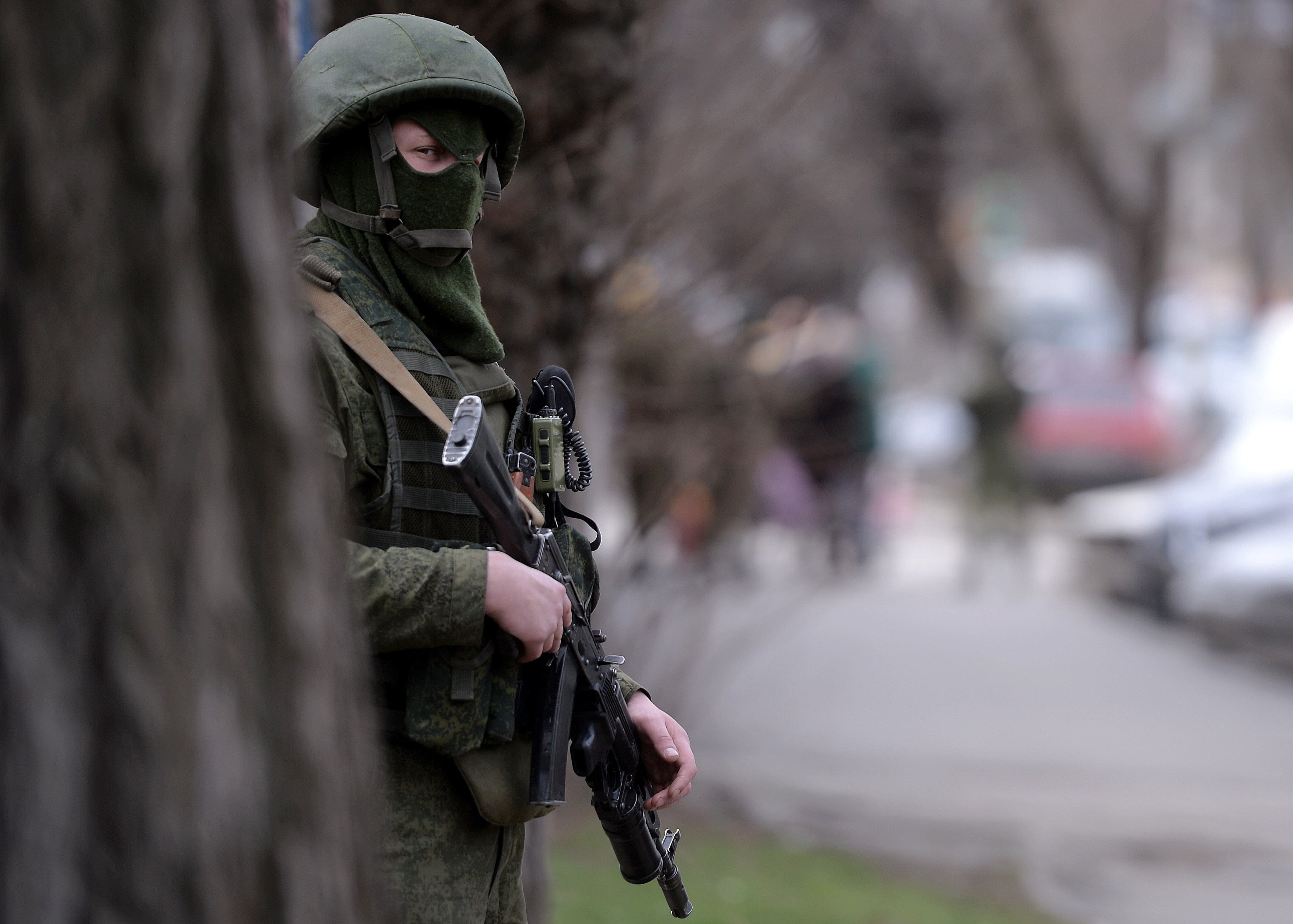 A Russian soldier stands guard outside the navy headquarters in Simferopol, Ukraine on  March 19, 2014.