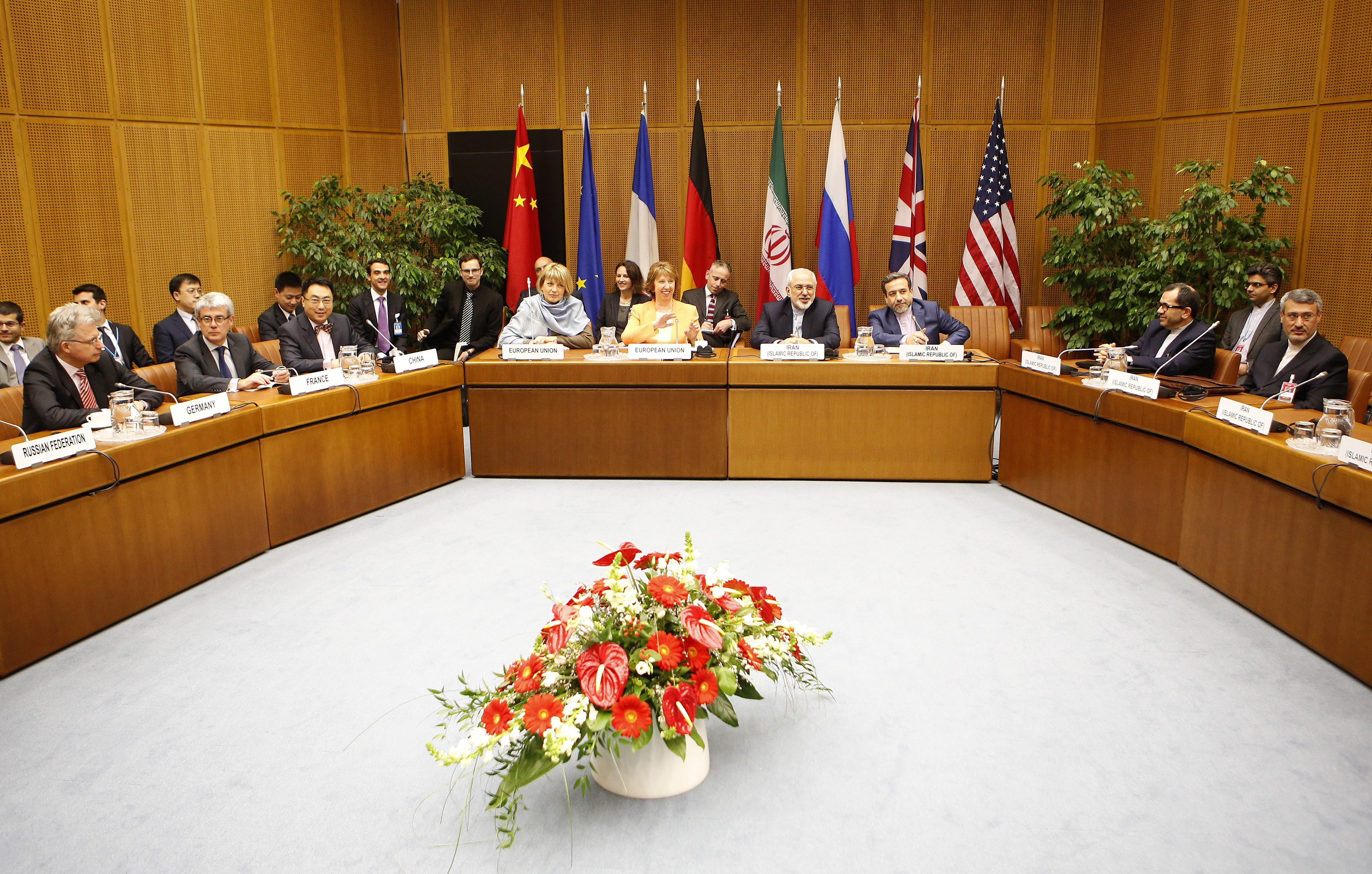 E.U. foreign-affairs representative Catherine Ashton, center left, and Iranian Foreign Minister Mohammad Javad Zarif, center right, attend the second day of the second round of nuclear talks with Iran at the U.N. headquarters in Vienna on March 19, 2014