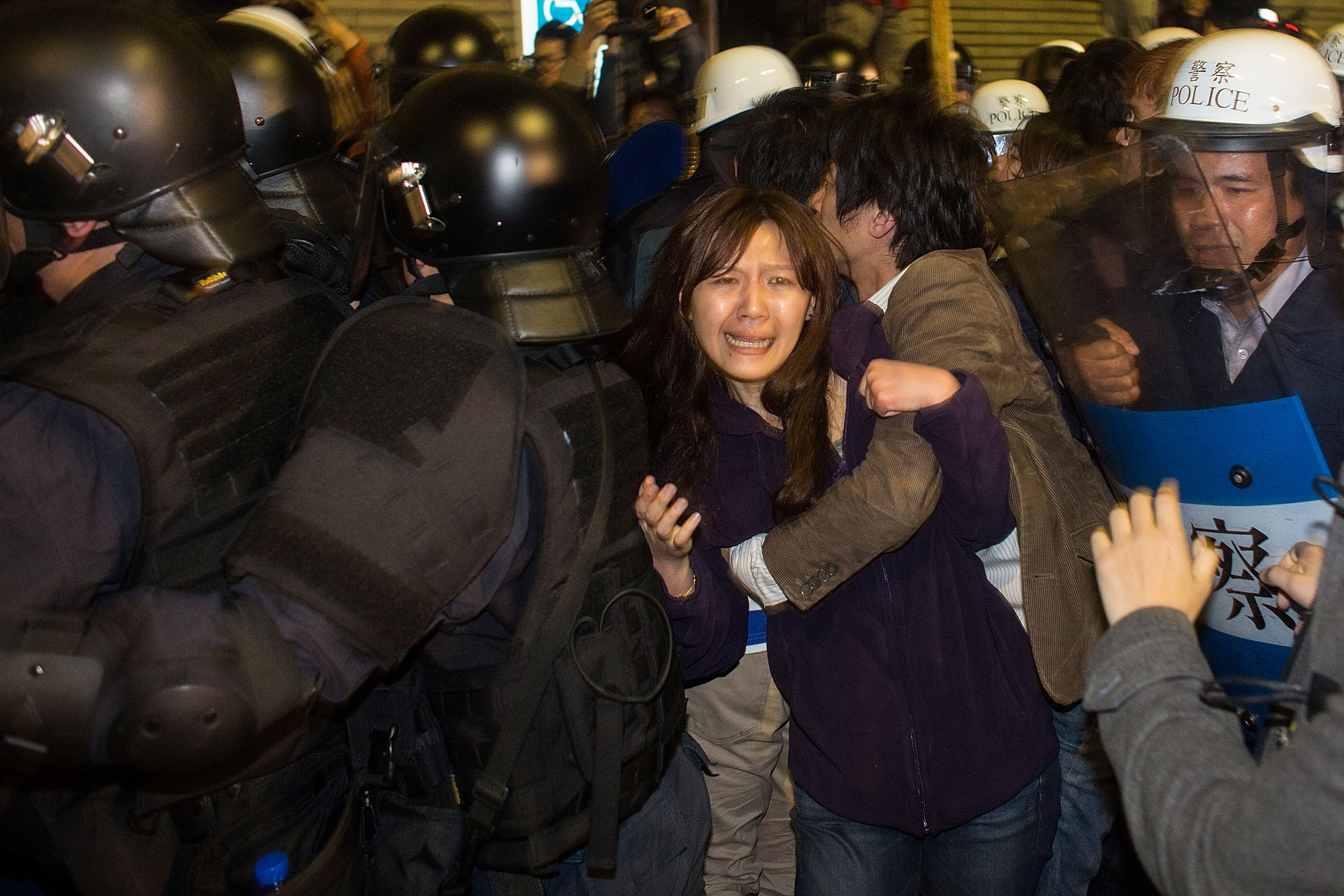 Riot police clash with student protesters outside Taiwan's cabinet offices in Taipei on March 24, 2014. Clashes erupted after Taiwan's President refused to scrap a contentious trade agreement with China and denounced the  illegal  occupation of government buildings by students opposed to its ratification