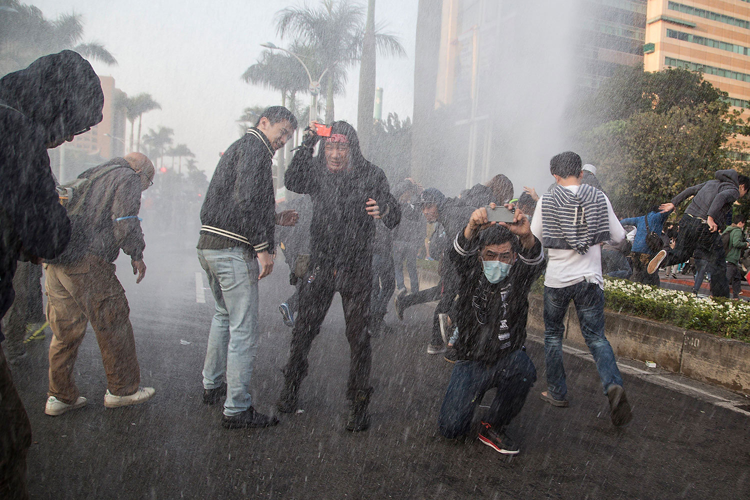 Riot police use water cannons during a clash with student protesters outside the Executive Yuan, a branch of government in charge of administrative affairs for all of Taiwan on March 24, 2014 in Taipei, Taiwan.