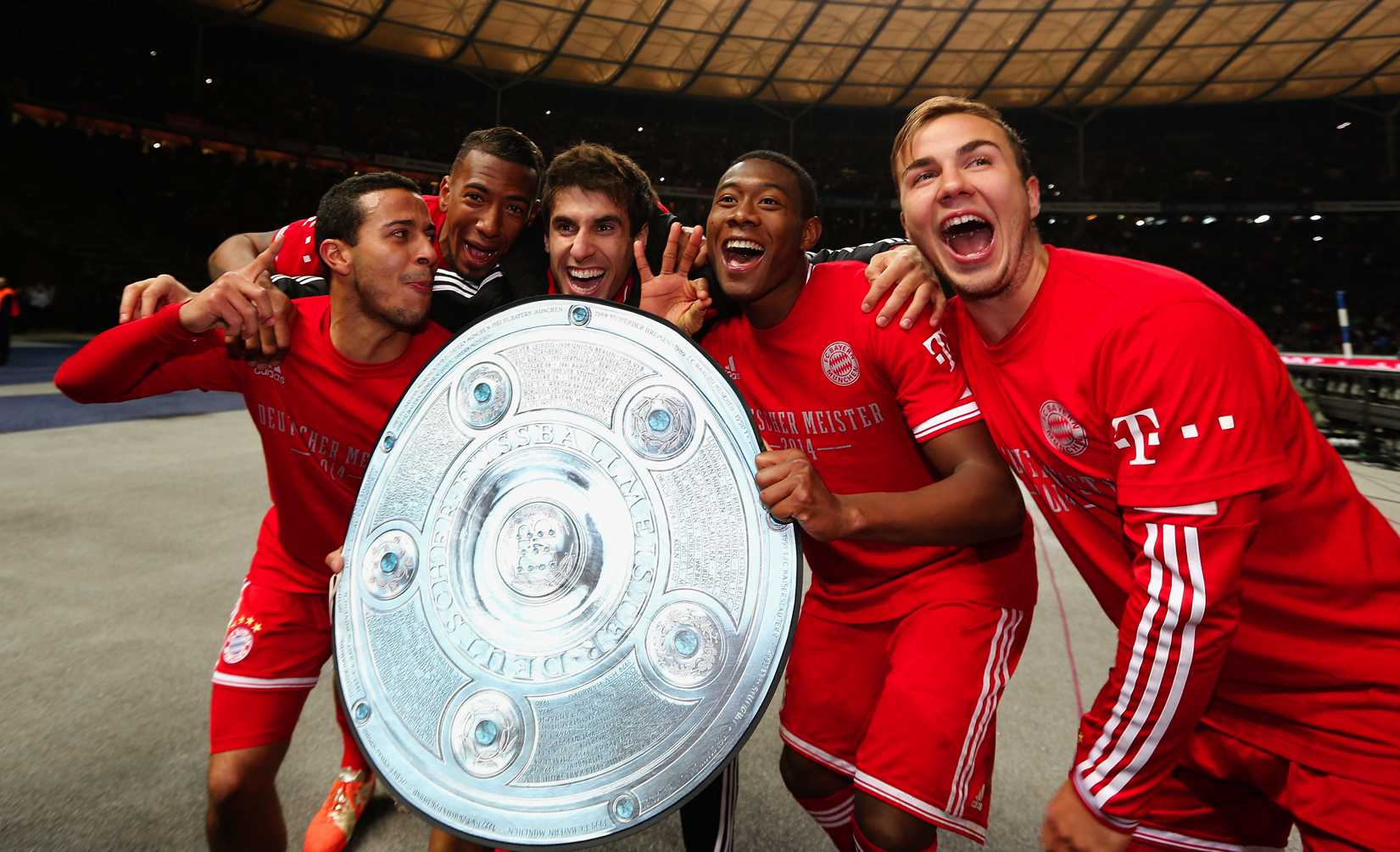 Thiago Alcantara, Jerome Boateng, Javier Martínez Aguinaga, David Alaba and Mario Goetze of Bayern Muenchen celebrate winning the German Championship after the Bundesliga match between Hertha BSC and FC Bayern Muenchen at Olympiastadion on March 25, 2014 in Berlin, Germany.