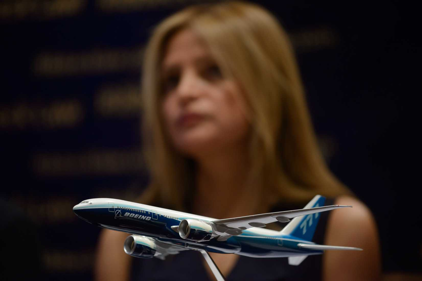 A model of a Boeing 777 aircraft is displayed as Monica Kelly of U.S. law firm Ribbeck Law attends a media briefing organized by the company at a hotel in Kuala Lumpur on March 26, 2014