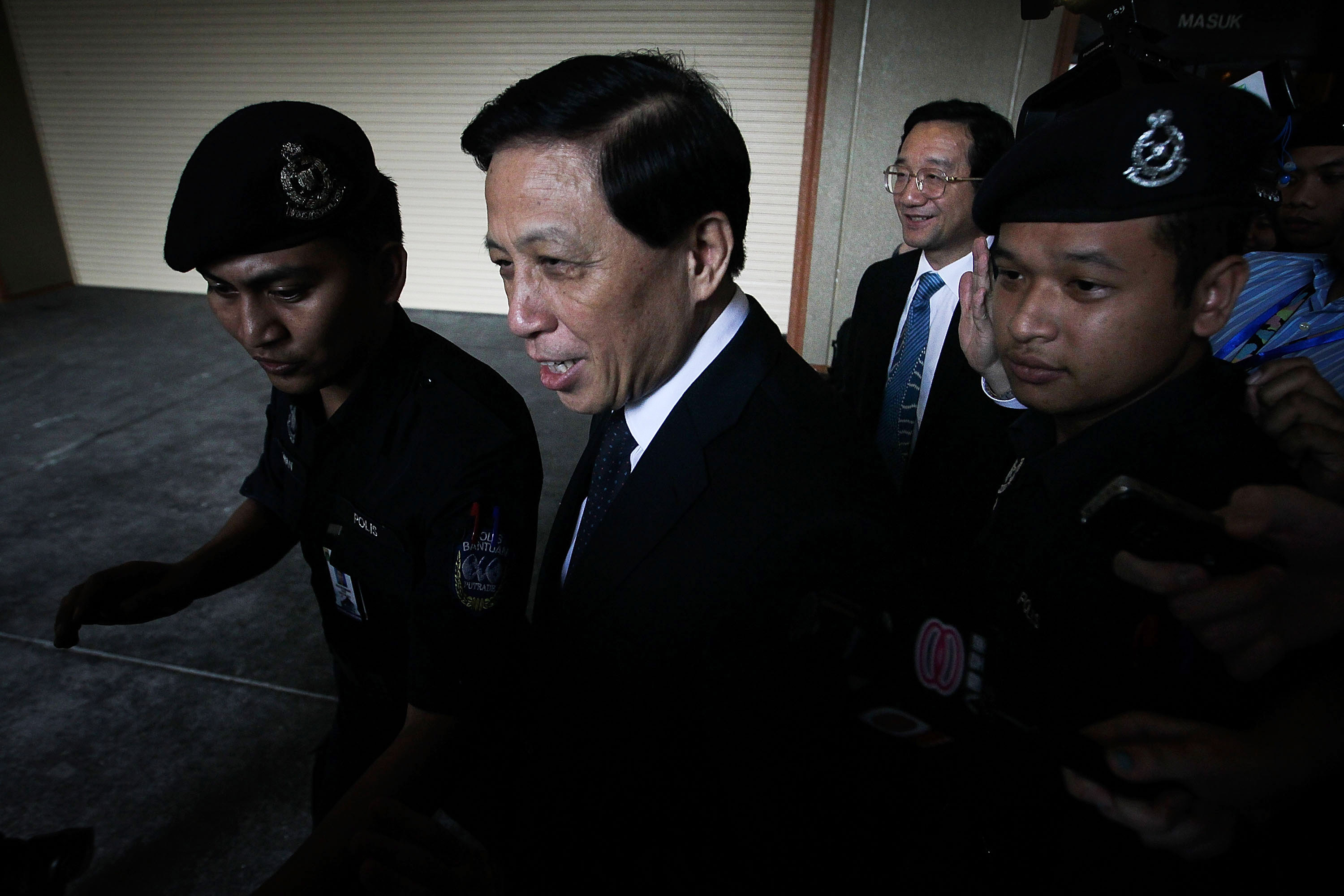 Chinese special envoy Zhang Yesui leaves after a meeting with Malaysian officials on March 26, 2014 in Kuala Lumpur. He is tasked with asking Malaysia to  properly handle  the investigation into the fate of MH370