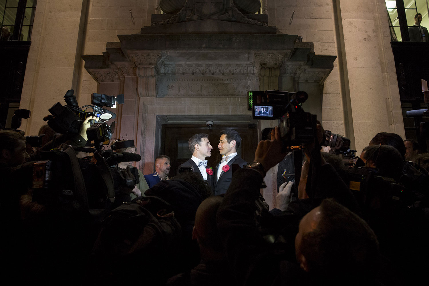 Gay couple Peter McGraith and David Cabreza stand on the steps of Islington Town Hall after being married shortly after midnight in one of the UK's first same-sex weddings on March 29, 2014 in London.