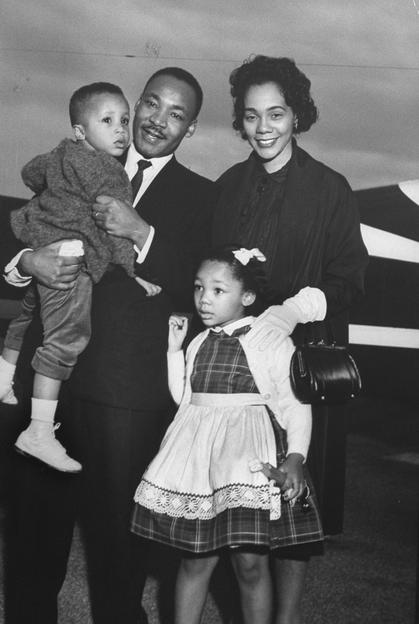 Civil Rights leader Dr. Martin Luther King Jr. holding his son Martin III as his daughter Bernice and wife Coretta greet him at the airport upon his release from Georgia State prison after incarceration for leading boycotts.