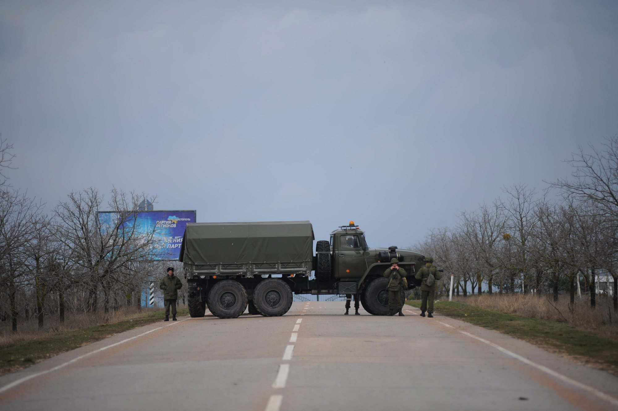 Russian troops block the road way towards the military airport at the Black Sea port of Sevastopol in Crimea, Feb. 28, 2014.