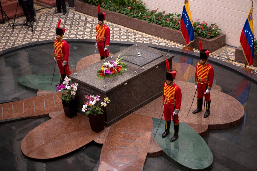 Presidential guards stand next to the tomb of Venezuela's late President Hugo Chavez at the former military barracks that was turned into Chavez's mausoleum in Caracas, March 5, 2014.