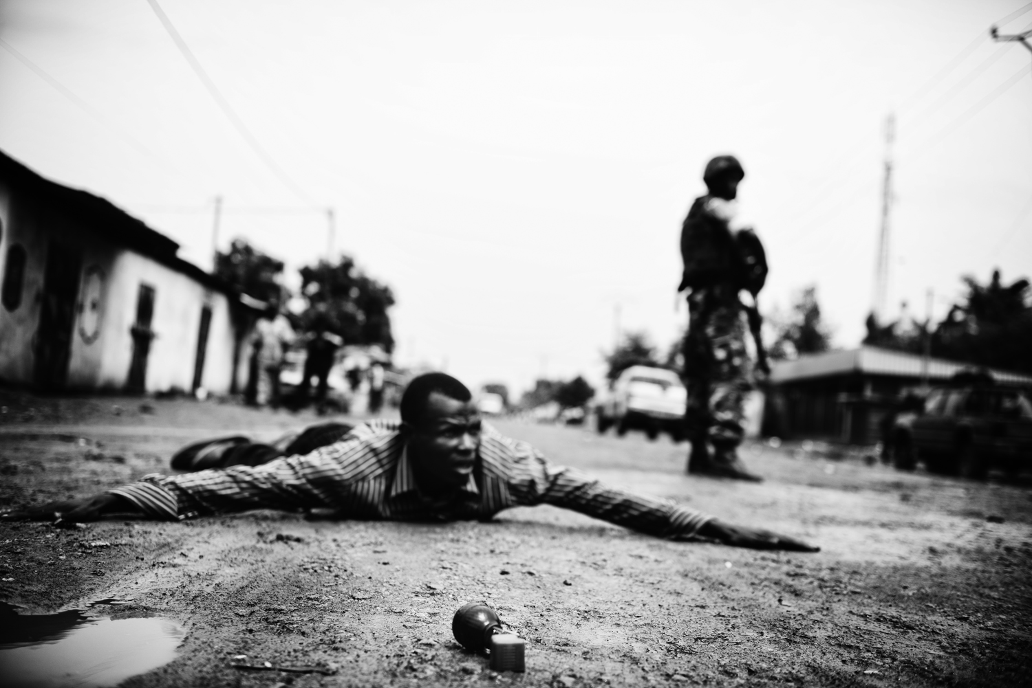 An ex-member of Séléka is immobilized by Burundian troops in the Fifth Arrondissement after he attempted to throw a hand grenade at their patrol. Feb. 1, 2014.
