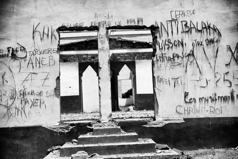 A destroyed mosque near the capital, littered with graffiti written by anti-balaka militiamen. Feb. 11, 2014.