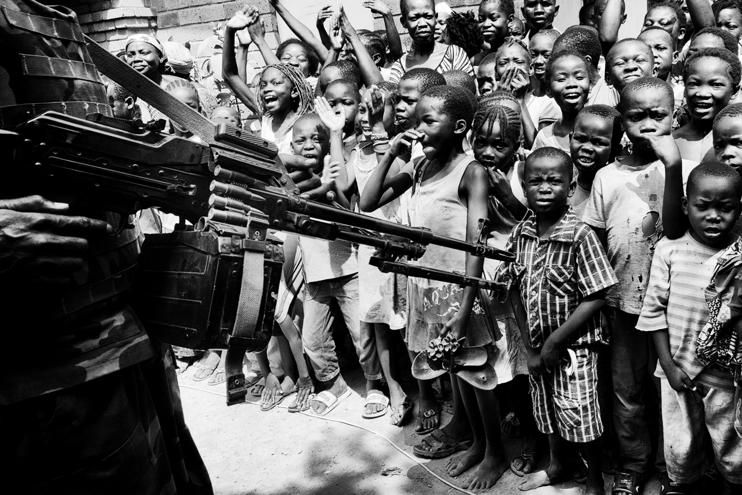 Rwandan soldiers contain a crowd of children at a refugee camp during a visit by interim President Catherine Samba-Panza. Jan. 31, 2014.