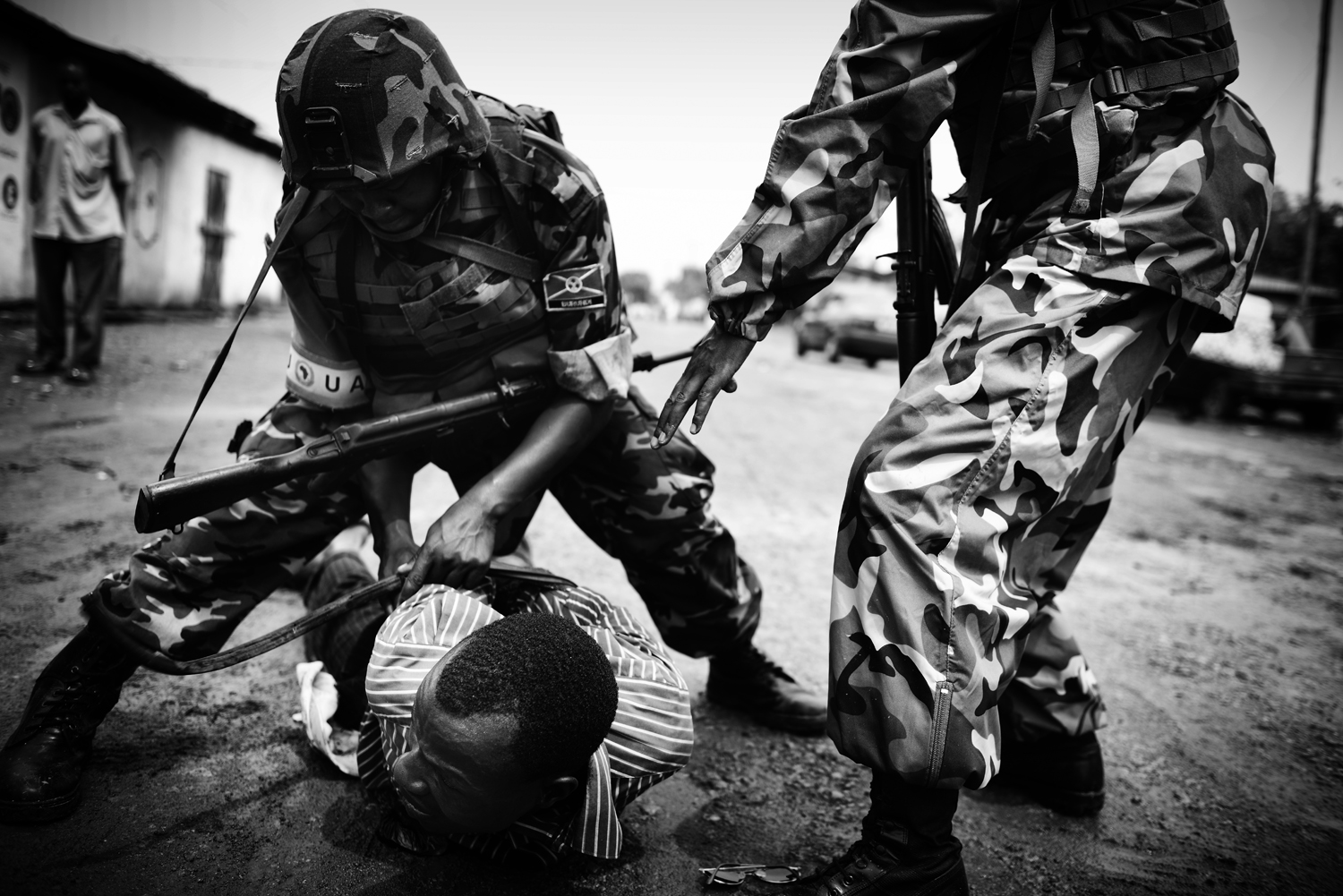 An ex-Séléka fighter is immobilized by African Union troops in the Miskine district. Feb. 1, 2014.