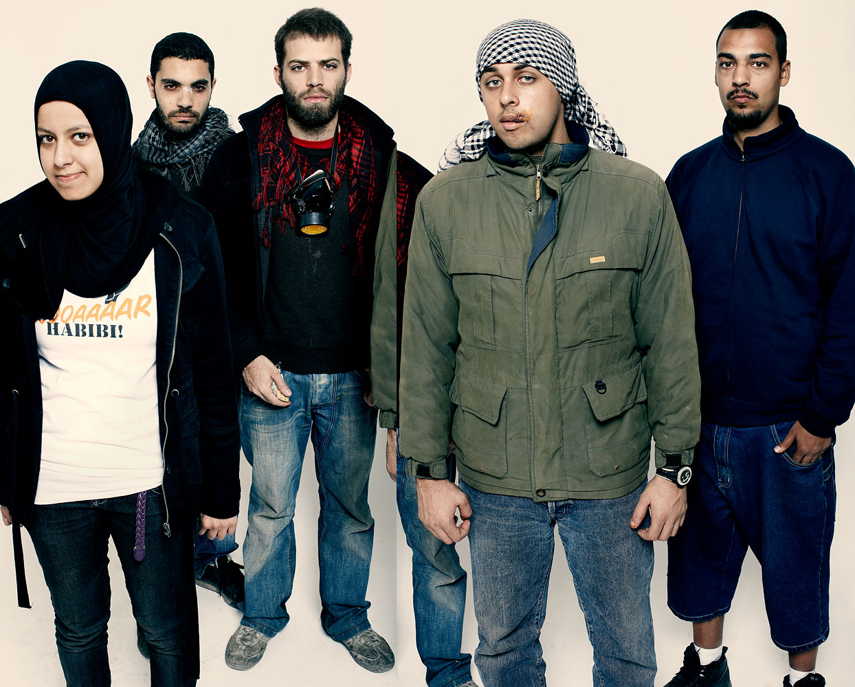 Ali Mustafa, far right, stands for a portrait in Cairo in November 2011 as TIME photographed protesters, who it named Person of the Year