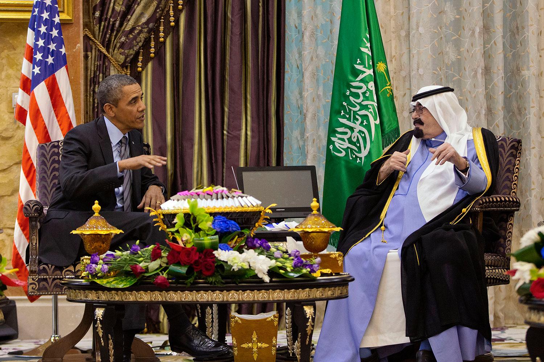 President Barack Obama meets with Saudi King Abdullah at Rawdat Khuraim, Saudi Arabia, March 28, 2014.