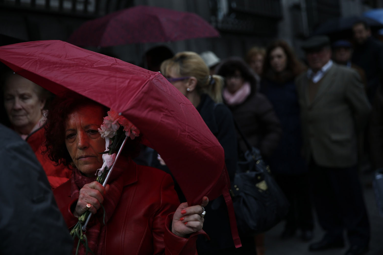 Mar. 24, 2014. People line up to pay their respects to Spain's former Prime Minister Adolfo Suarez during his wake at the Spanish parliament in Madrid. Suarez steered Spain through one of the most turbulent periods in its political history.