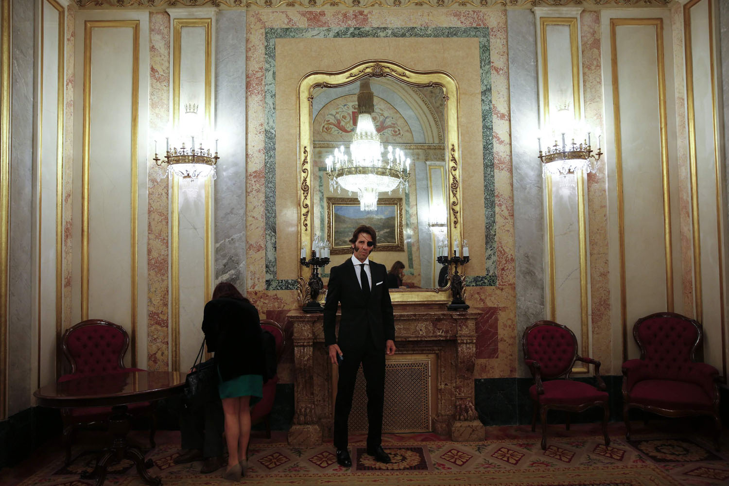 Mar. 24, 2014. Spanish bullfighter Juan Jose Padilla poses for the camera as he attends the wake of Spain's former Prime Minister Adolfo Suarez at the Spanish parliament in Madrid.