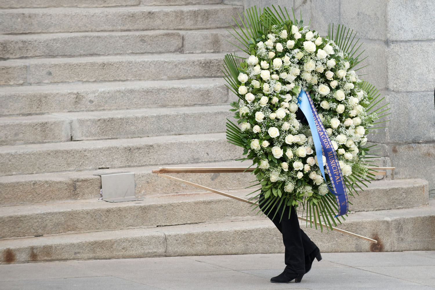 Mar. 24, 2014. A mourner carries flowers for the funeral of former Spanish president Adolfo Suarez, who led Spain to democracy after decades of dictatorship.