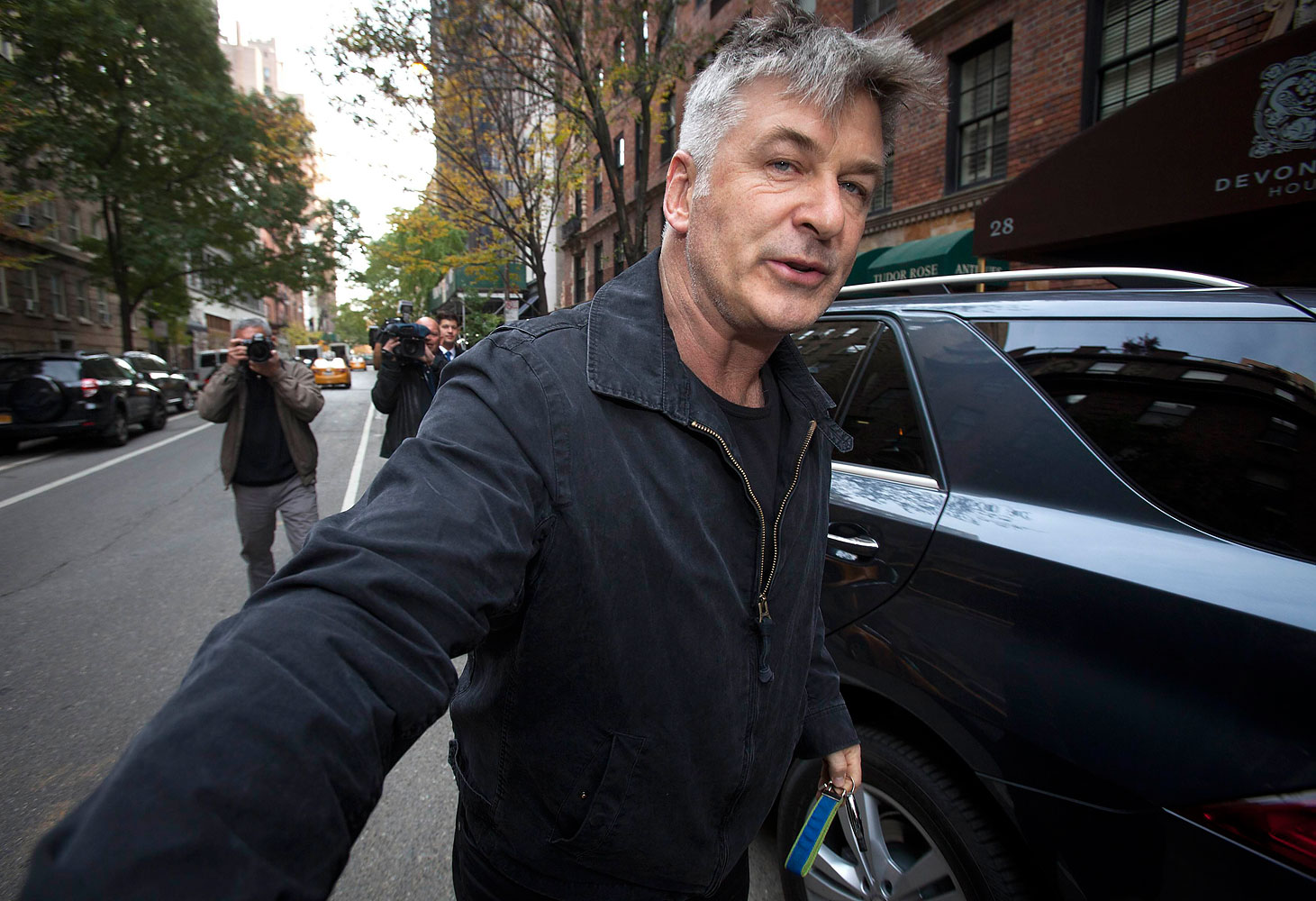 Actor Alec Baldwin shoves a photographer and tells him to move out of his way after he arrived at his home in New York on November 15, 2013.