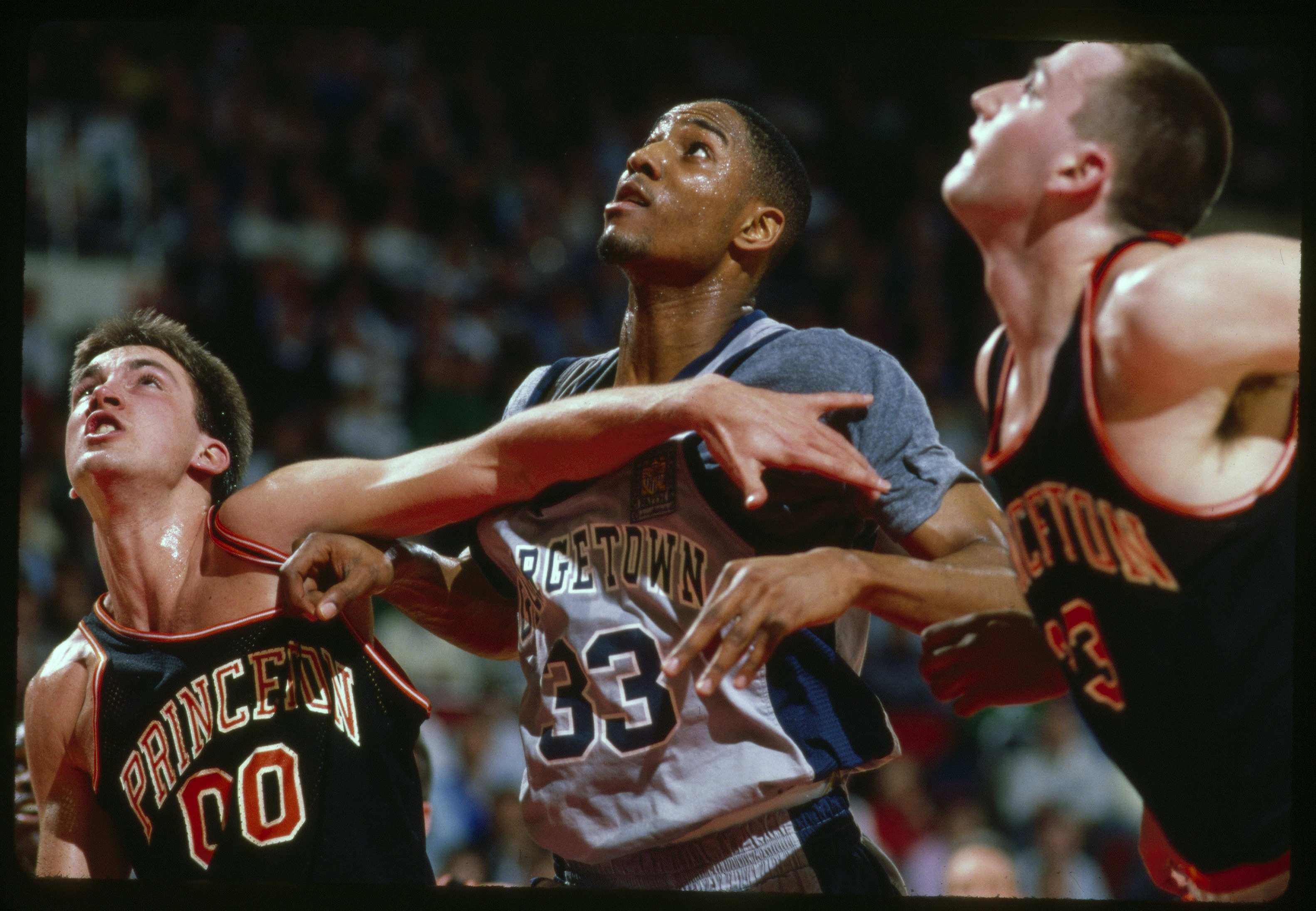 Georgetown's Alonzo Mourning (center) versus Princeton's Matt Lapin (33) and Kit Mueller (00) at Providence Civic Center, in Providence, R.I., on March 17, 1989.