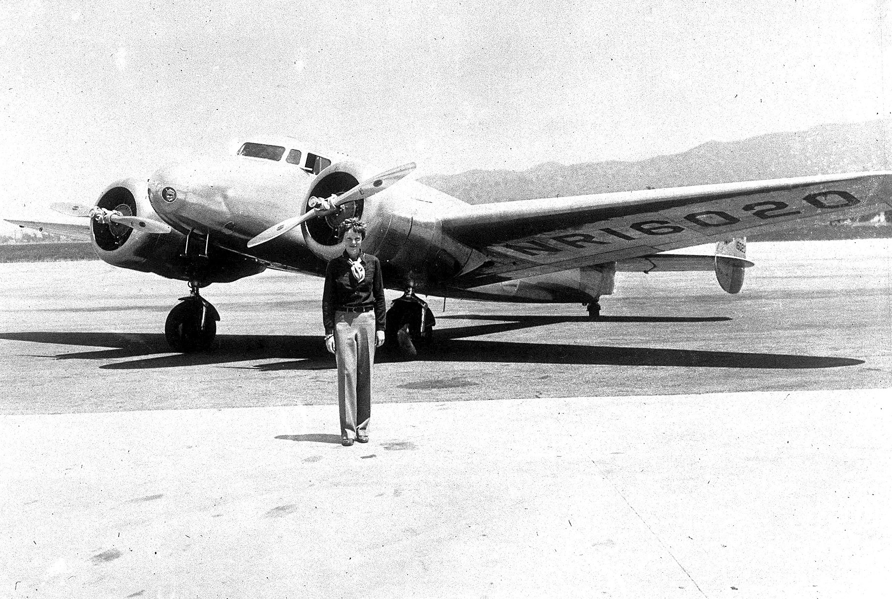 Amelia Earhart is pictured with her Flying Laboratory in which she attempted to fly around the world from Oakland, Ca.