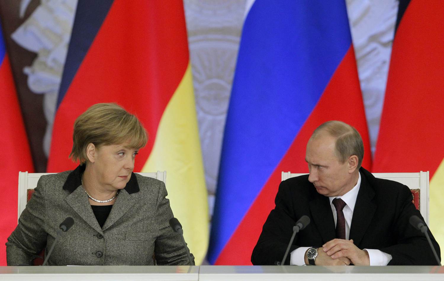 From left: German Chancellor Angela Merkel and Russian President Vladimir Putin answer journalists' questions during a joint news conference in Moscow's Kremlin Nov. 16, 2012.