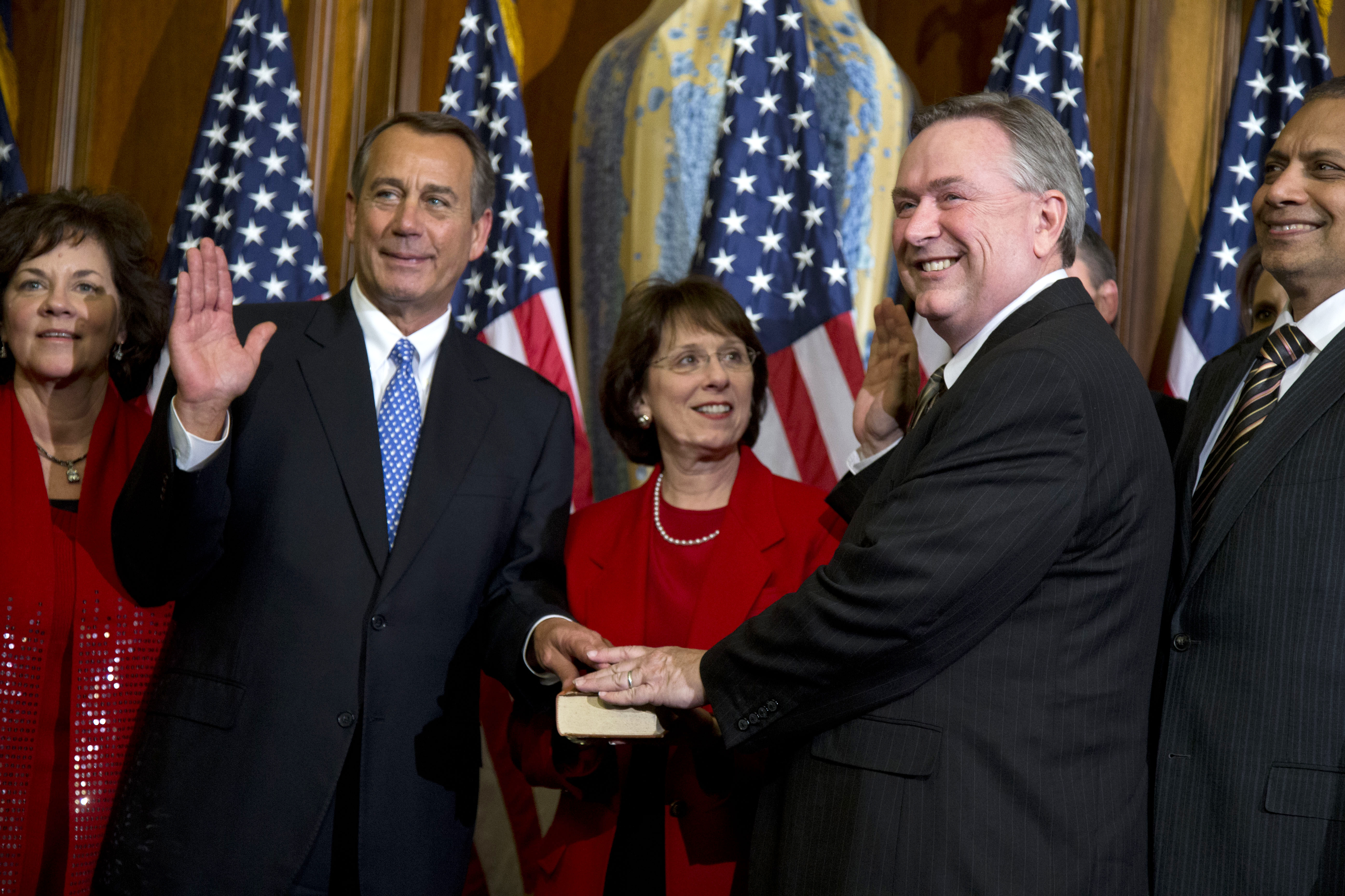 Rep. Steve Stockman, R-Texas, second from right, participates in a mock swearing-in ceremony with Speaker of the House Rep. John Boehner, R-Ohio, for the 113th Congress in Washington, Jan. 3, 2013.
