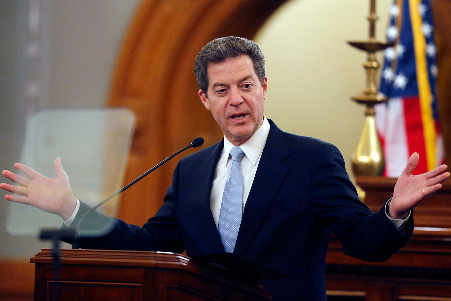 Kansas Gov. Sam Brownback delivers his State of the State speech to an annual joint session of the state House and Senate at the Statehouse in Topeka, Kan., Jan. 15, 2014.
