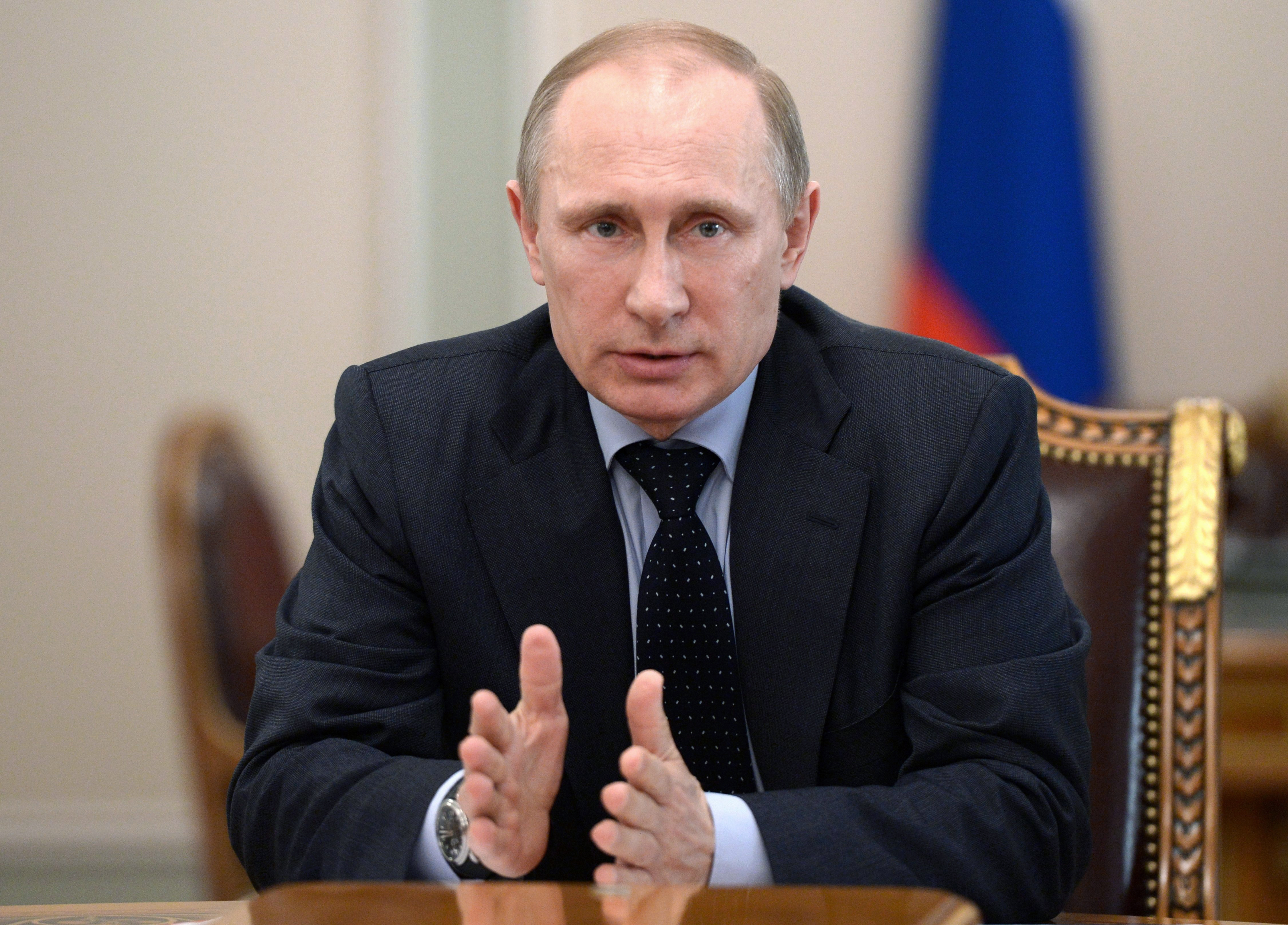 Russian President Vladimir Putin speaks at a Security Council meeting in the Kremlin in Moscow, Russia, Friday, March 28, 2014.
